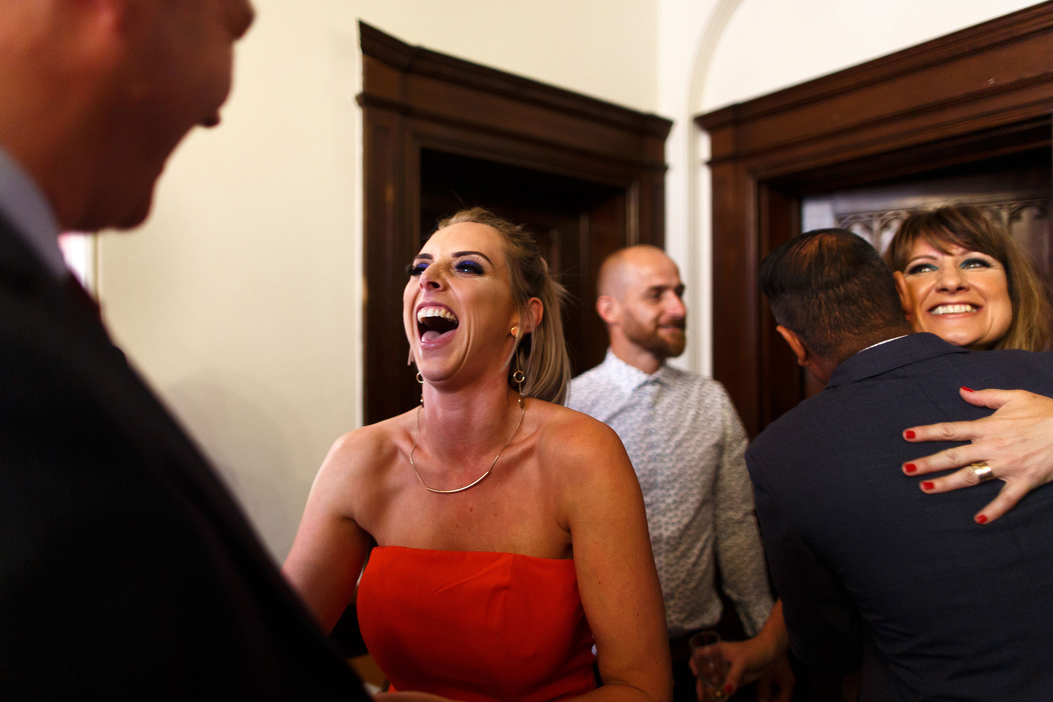 Wedding guests laughing | Hargate Hall Wedding Photography