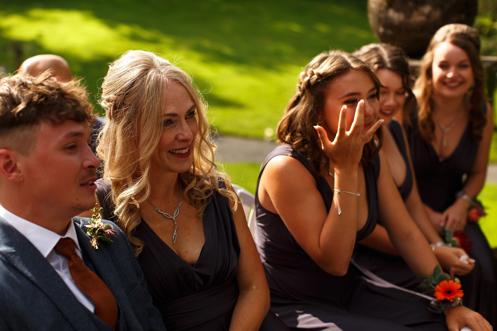 Bridesmaids looking emotional during outdor wedding ceremony | Hargate Hall Wedding Photography