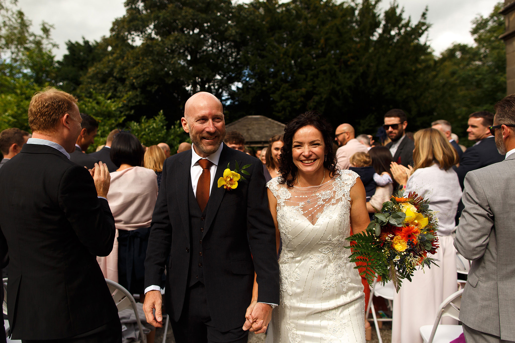 Bride and groom walking down the aisle | Hargate Hall Wedding Photography