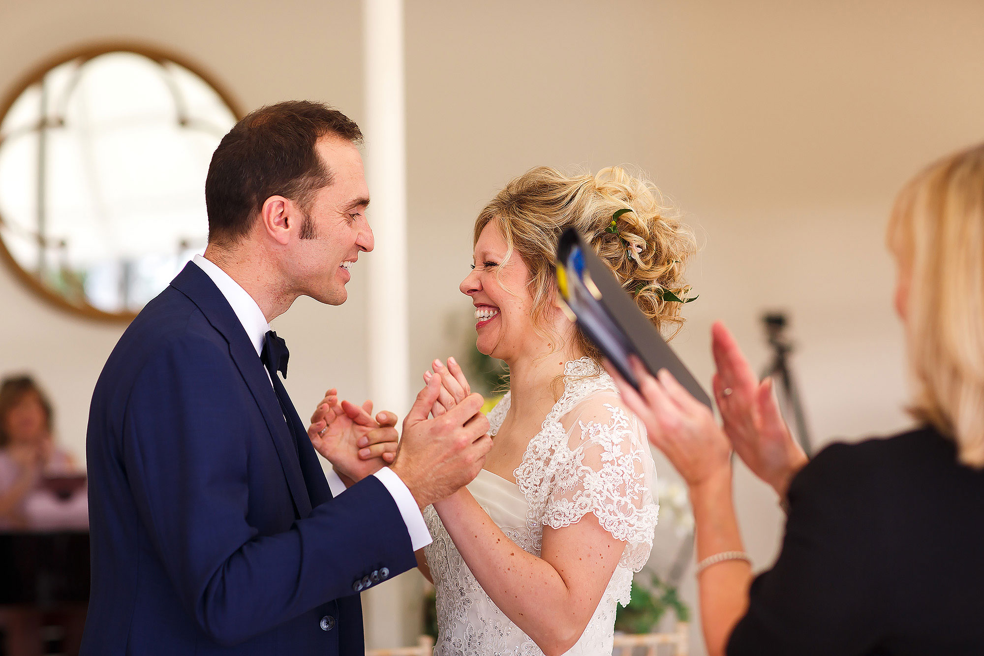 Bride and groom looking happy during wedding ceremony inside the Orangerie at Combermere Abbey Wedding