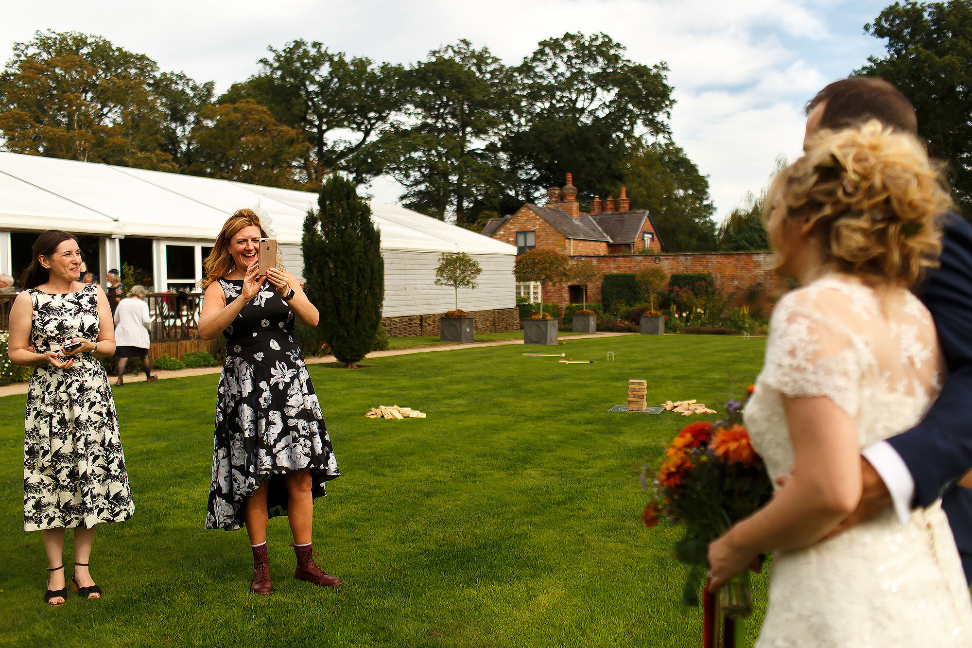 Wedding guests playing garden games on on the lawn at Combermere Abbey Wedding