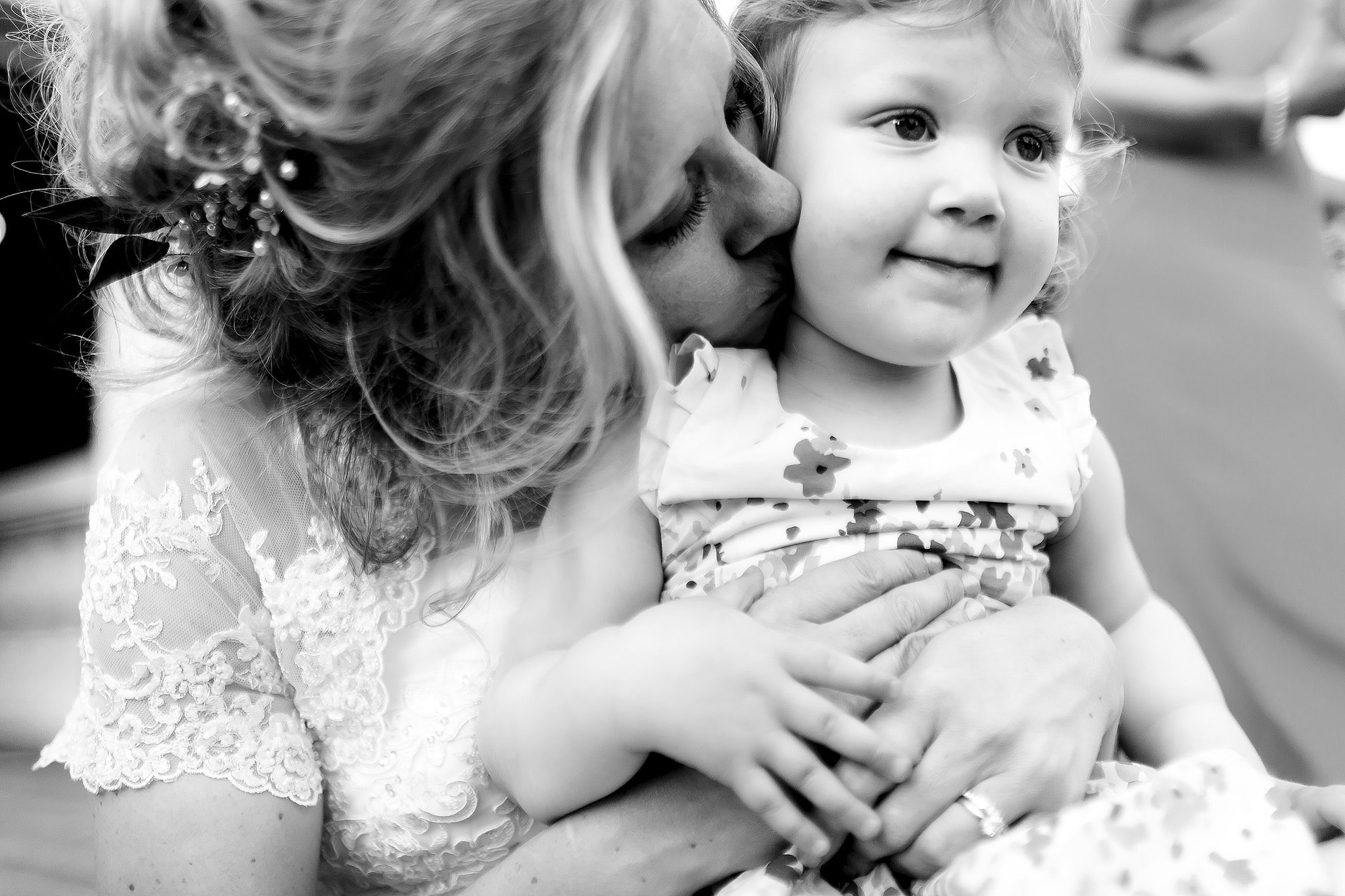 Gorgeous moment between bride and flower girl at Combermere Abbey Wedding