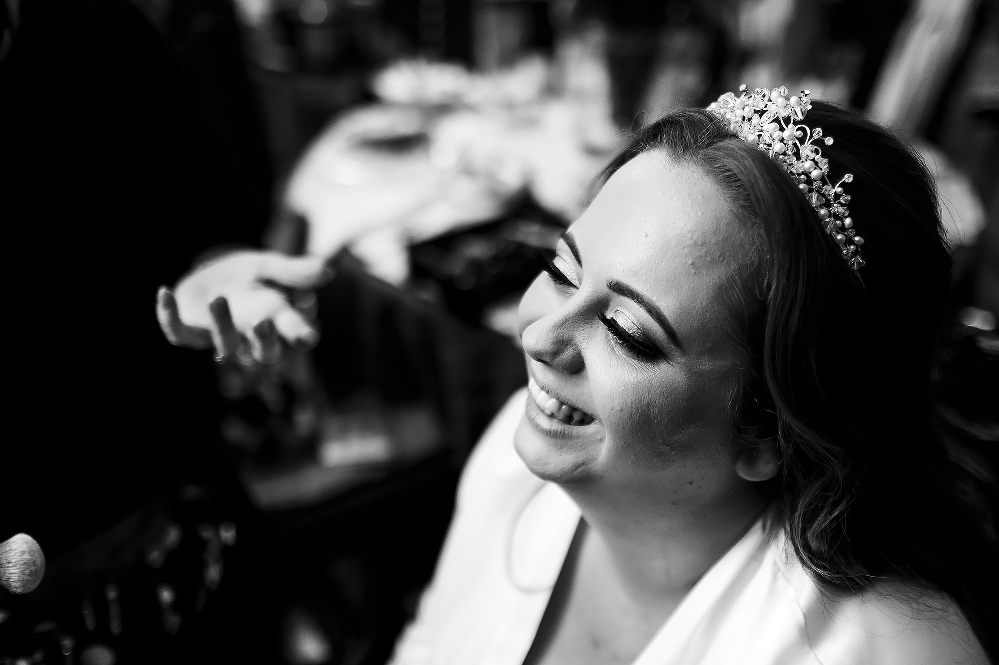 Bride wearing long eyelashes and hairpiece having make up applied on wedding morning | Wellbeing Farm wedding photographs by Toni Darcy Photography