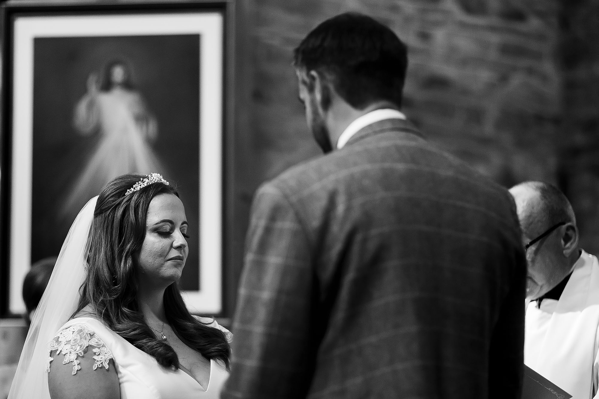 Bride closing her eyes taking in the moment as she says wedding vows | Wellbeing Farm wedding photographs by Toni Darcy Photography