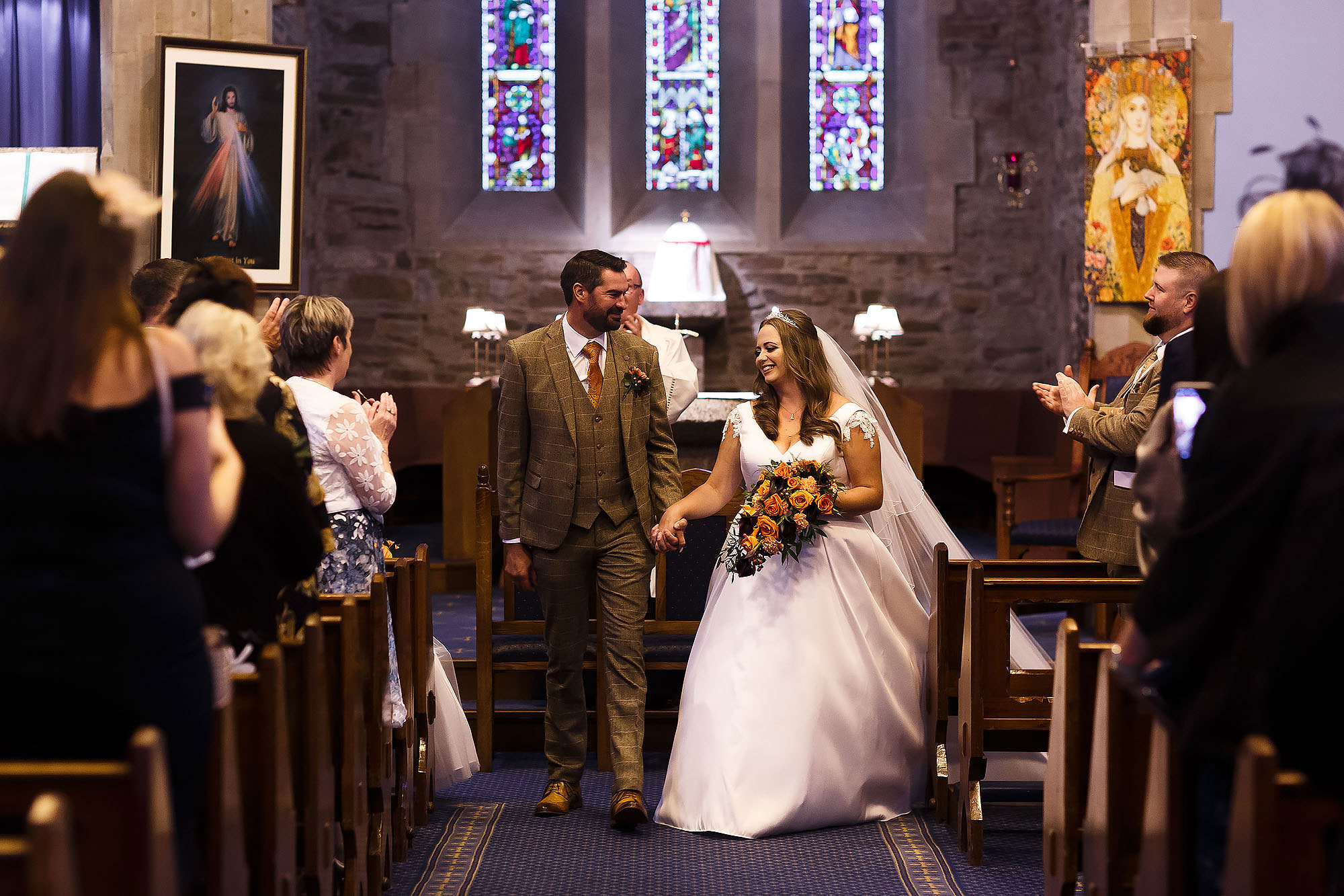 Bride and Groom walking down the aisle as husband and wife at St James the Less Rawtenstall | Wellbeing Farm wedding photographs by Toni Darcy Photography