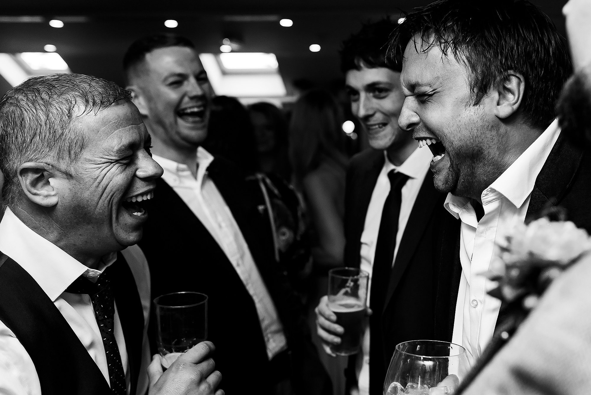 Wedding guests laughing enjoying the drinks reception at Wellbeing Farm | Wellbeing Farm wedding photographs by Toni Darcy Photography