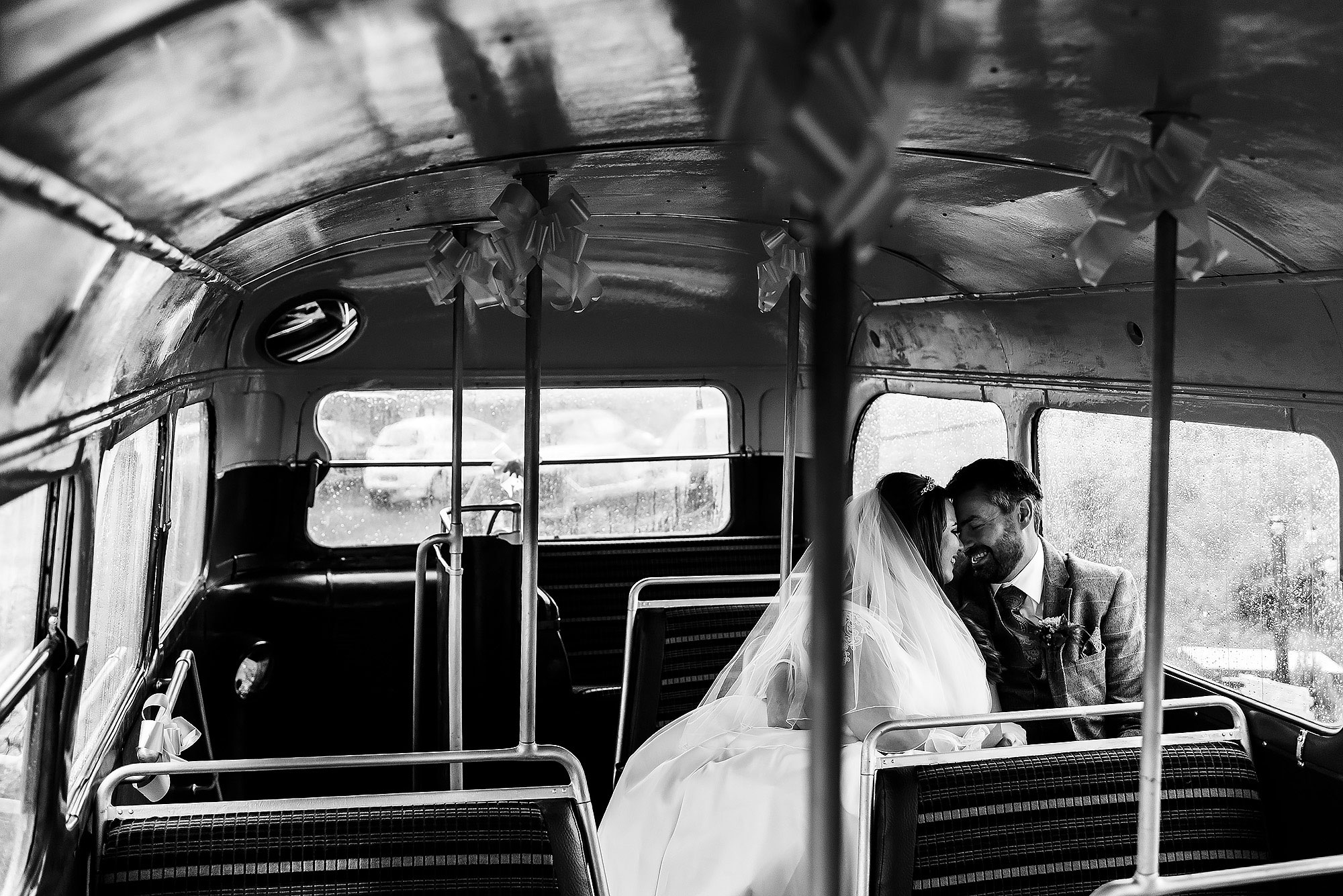 Bride and Groom enjoying a private moment on the wedding bus at the wellbeing farm | Wellbeing Farm wedding photographs by Toni Darcy Photography