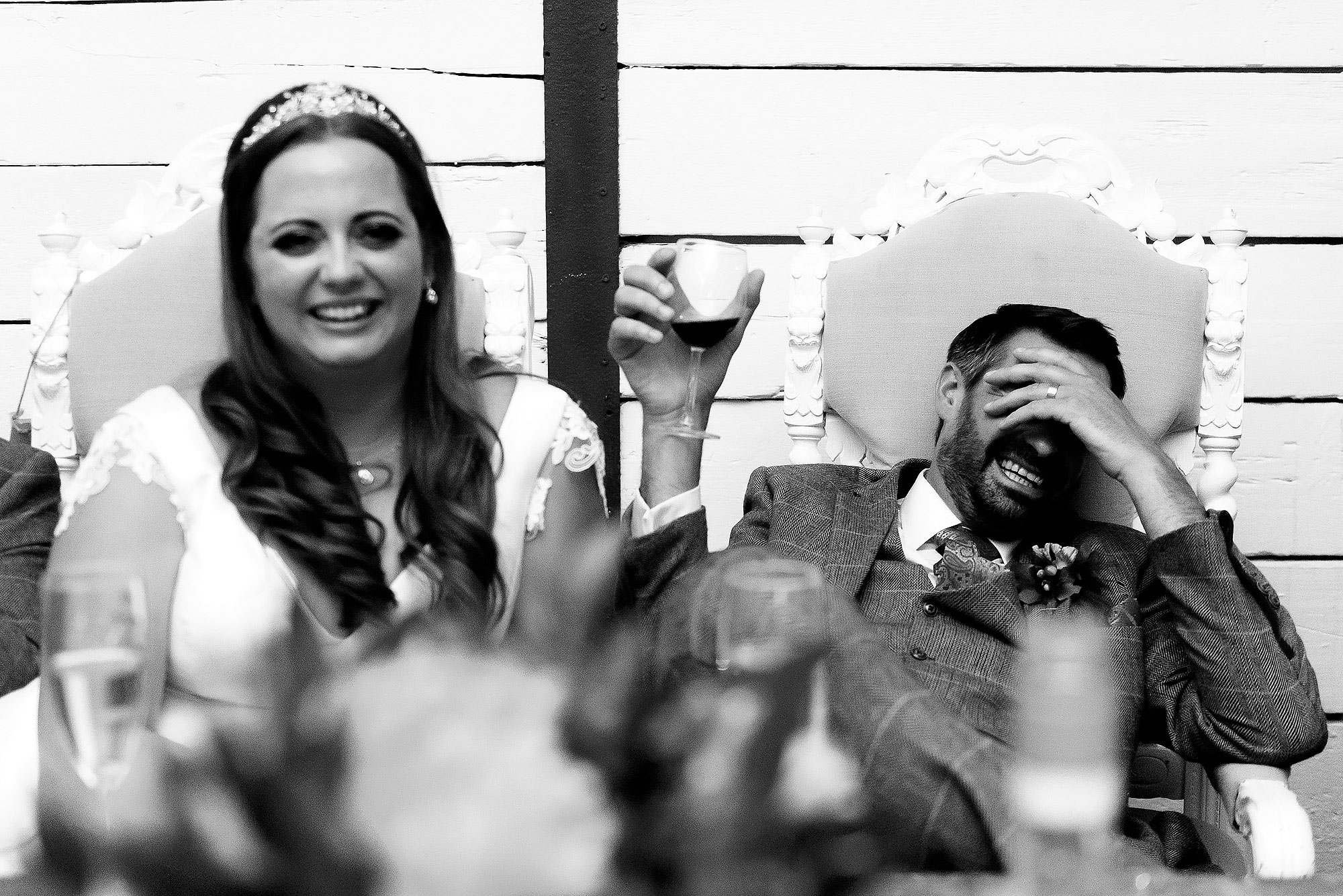 Bride and Groom crying laughing during wedding speeches | Wellbeing Farm wedding photographs by Toni Darcy Photography