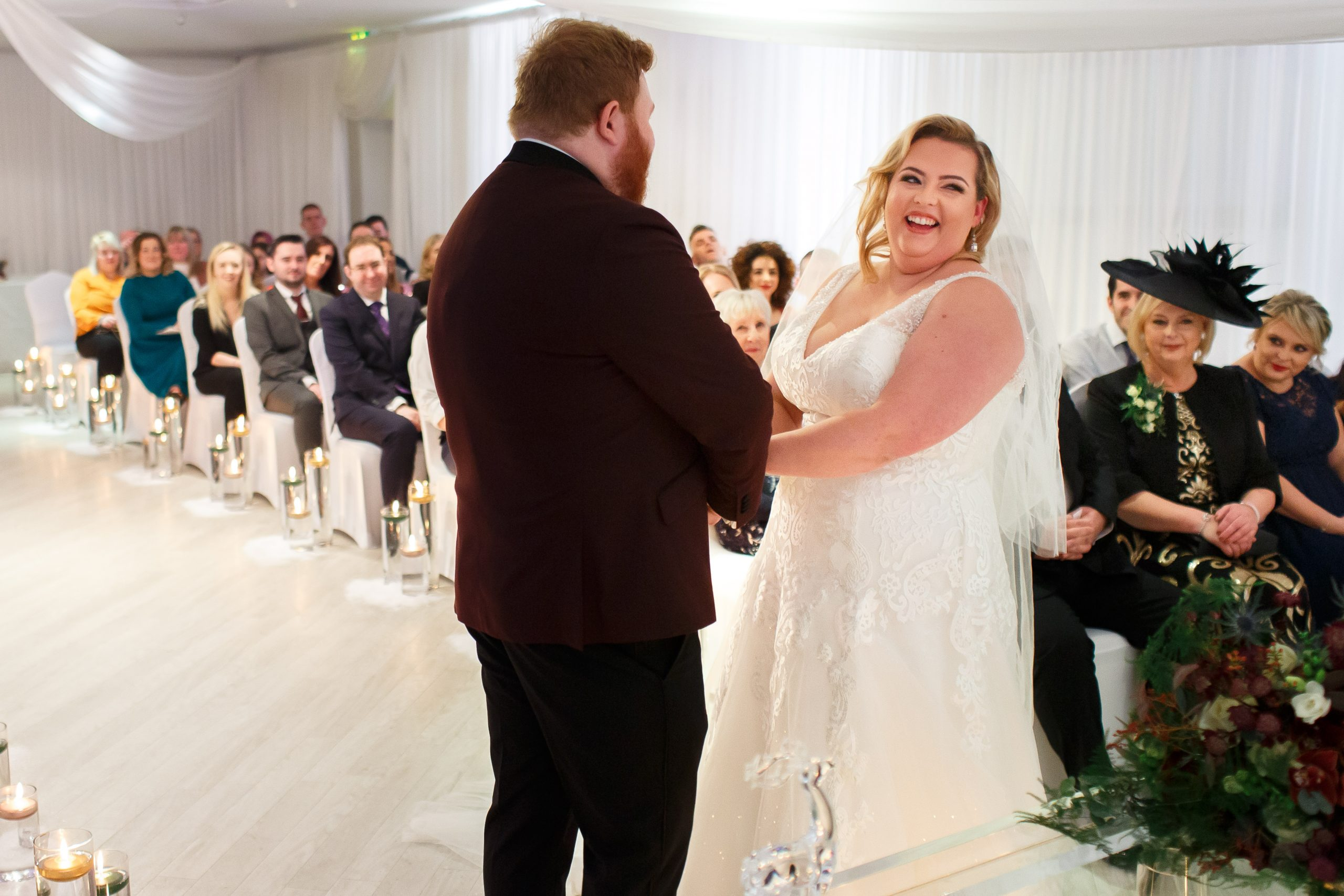 Bride laughing during wedding ceremony | Foxfields Country House Wedding Photography