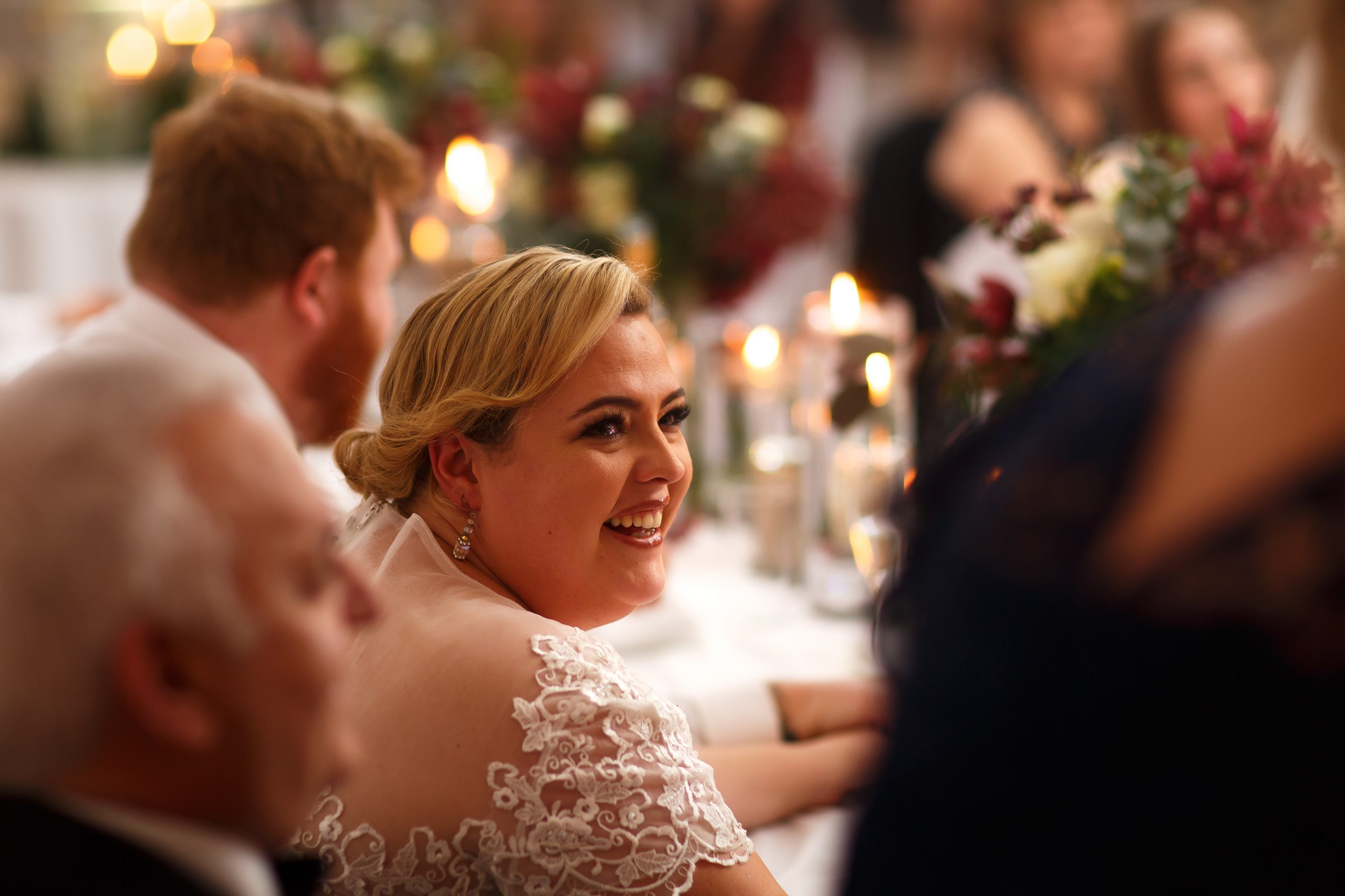Bride with 50s hair laughing during speeches | Foxfields Country House Wedding Photography