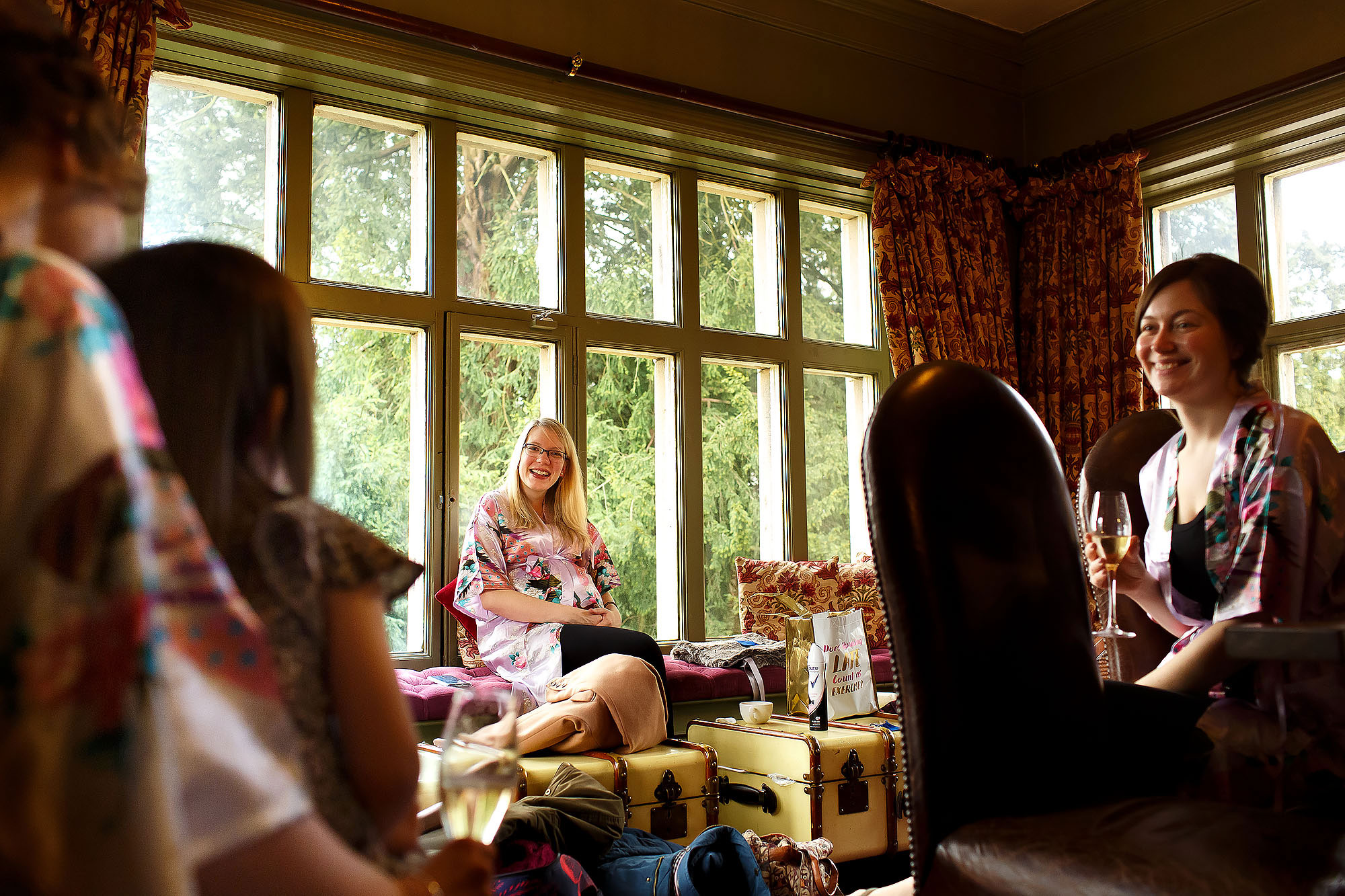 Bride getting ready with bridesmaids at Mitton Hall | Mitton Hall wedding photographs by Toni Darcy Photography