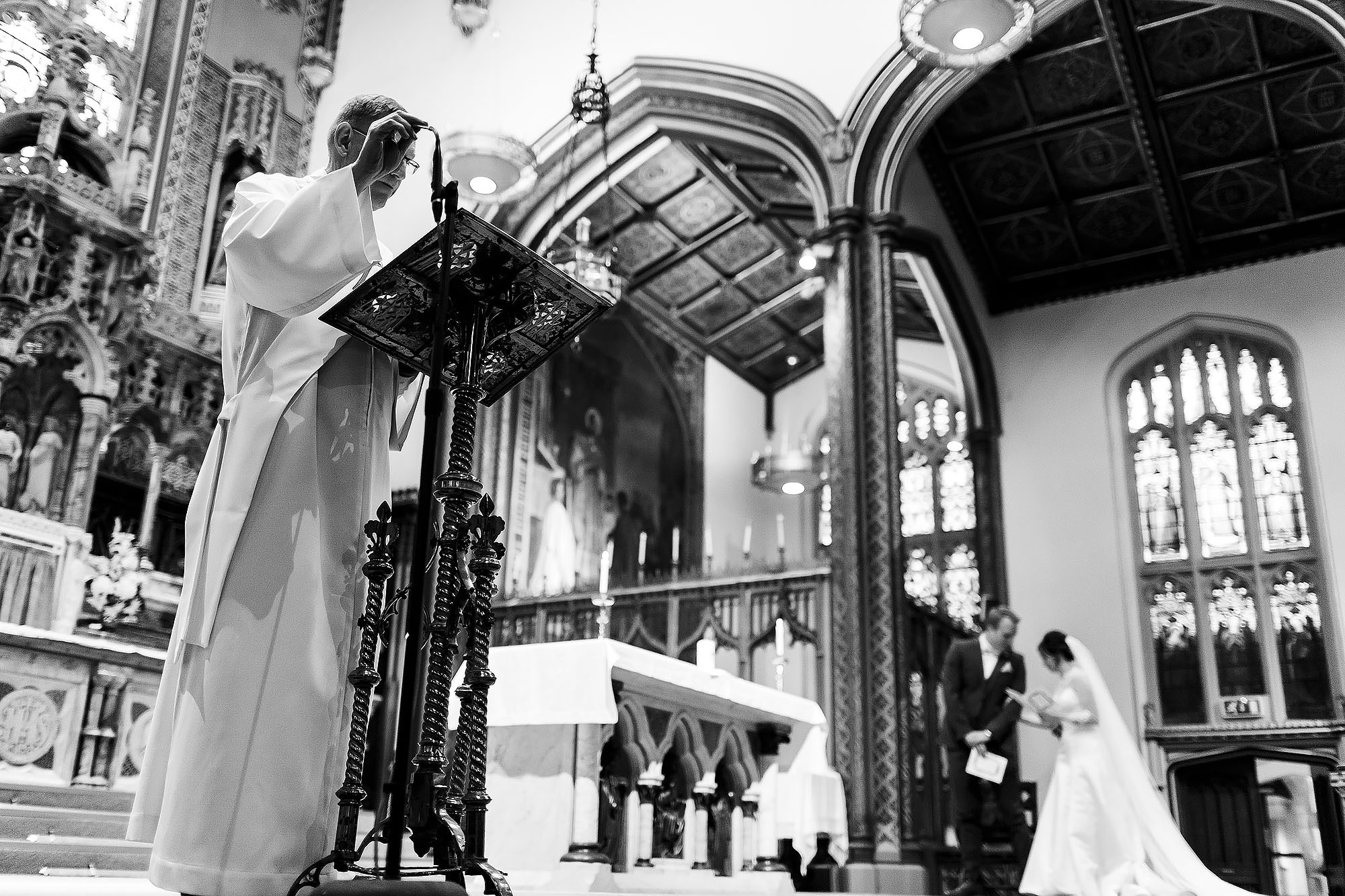 Priest giving sermon during wedding ceremony at St Peters Stonyhurst | Mitton Hall wedding photographs by Toni Darcy Photography