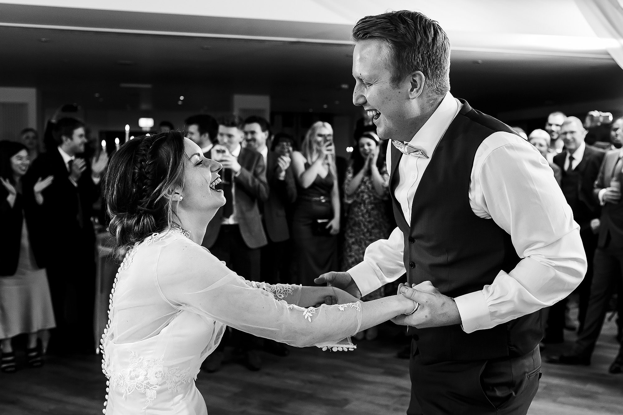Bride and Groom dancing in each others arms | Mitton Hall wedding photographs by Toni Darcy Photography
