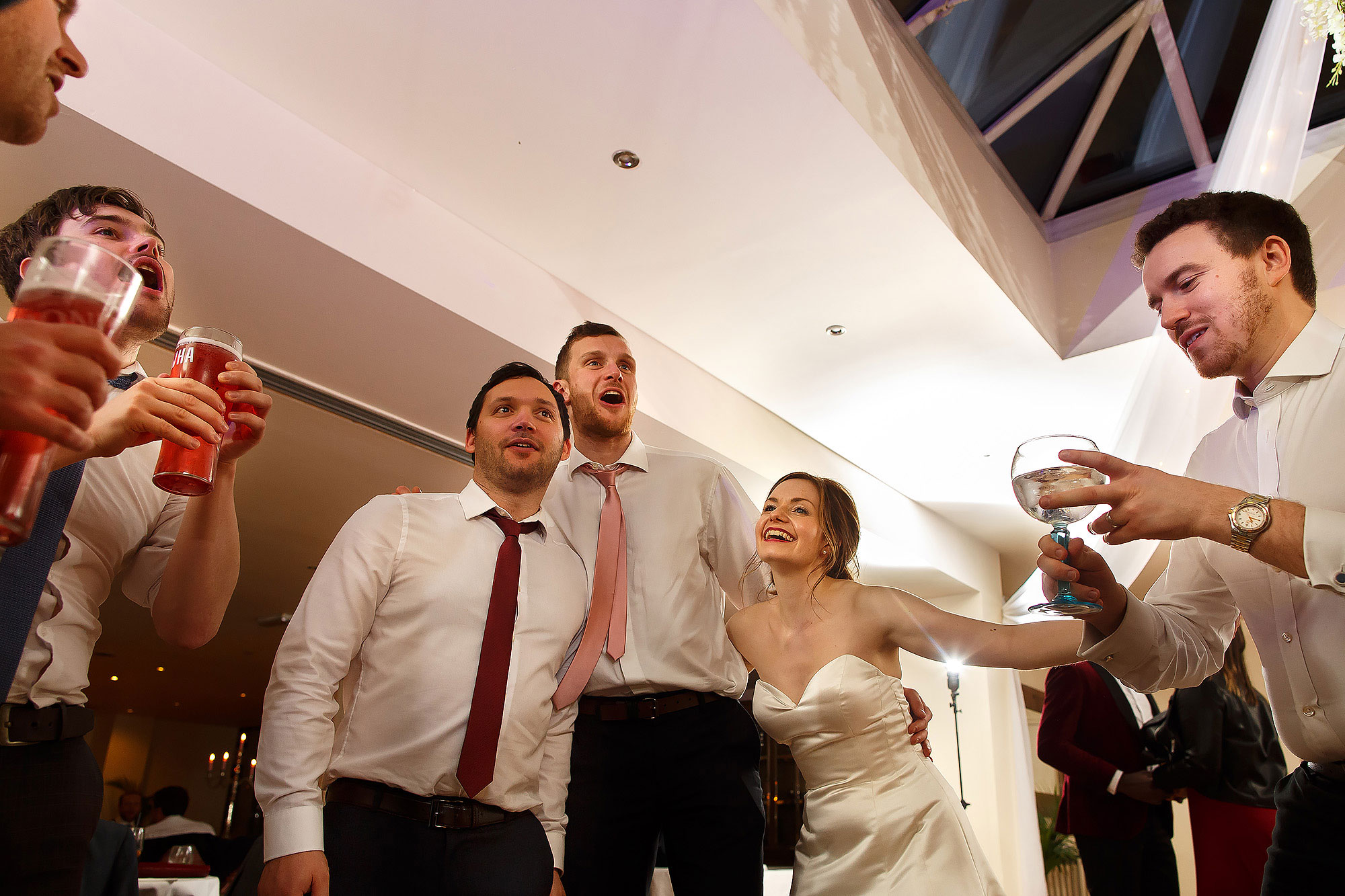 Bride on the dance floor with wedding guests | Mitton Hall wedding photographs by Toni Darcy Photography