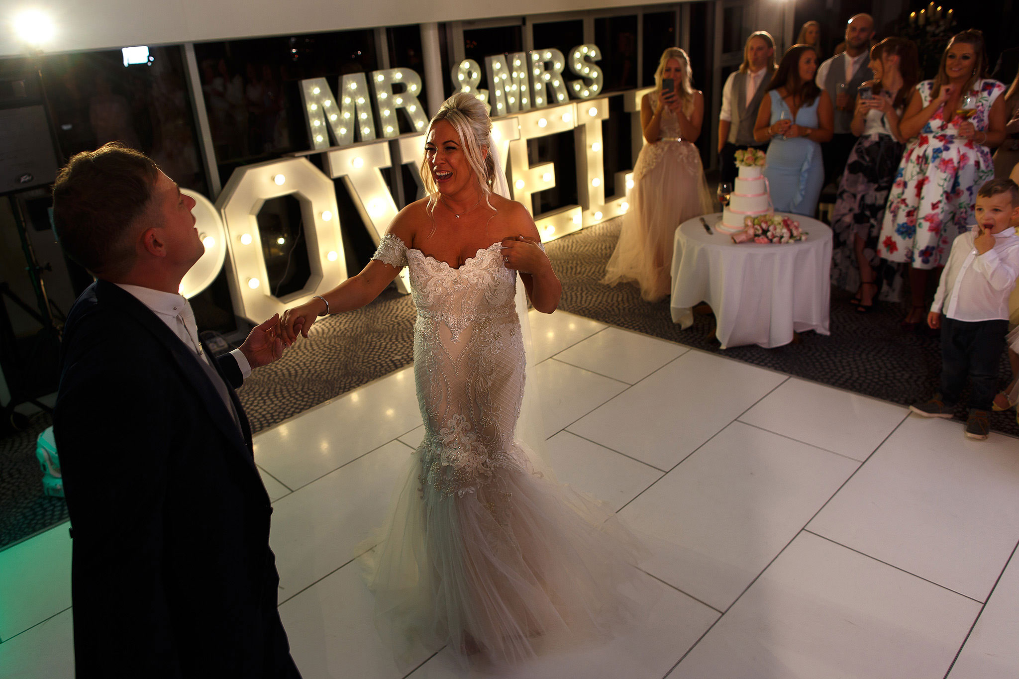 Bride and groom on the dance floor with light up letters behind them at Hurlston Hall wedding