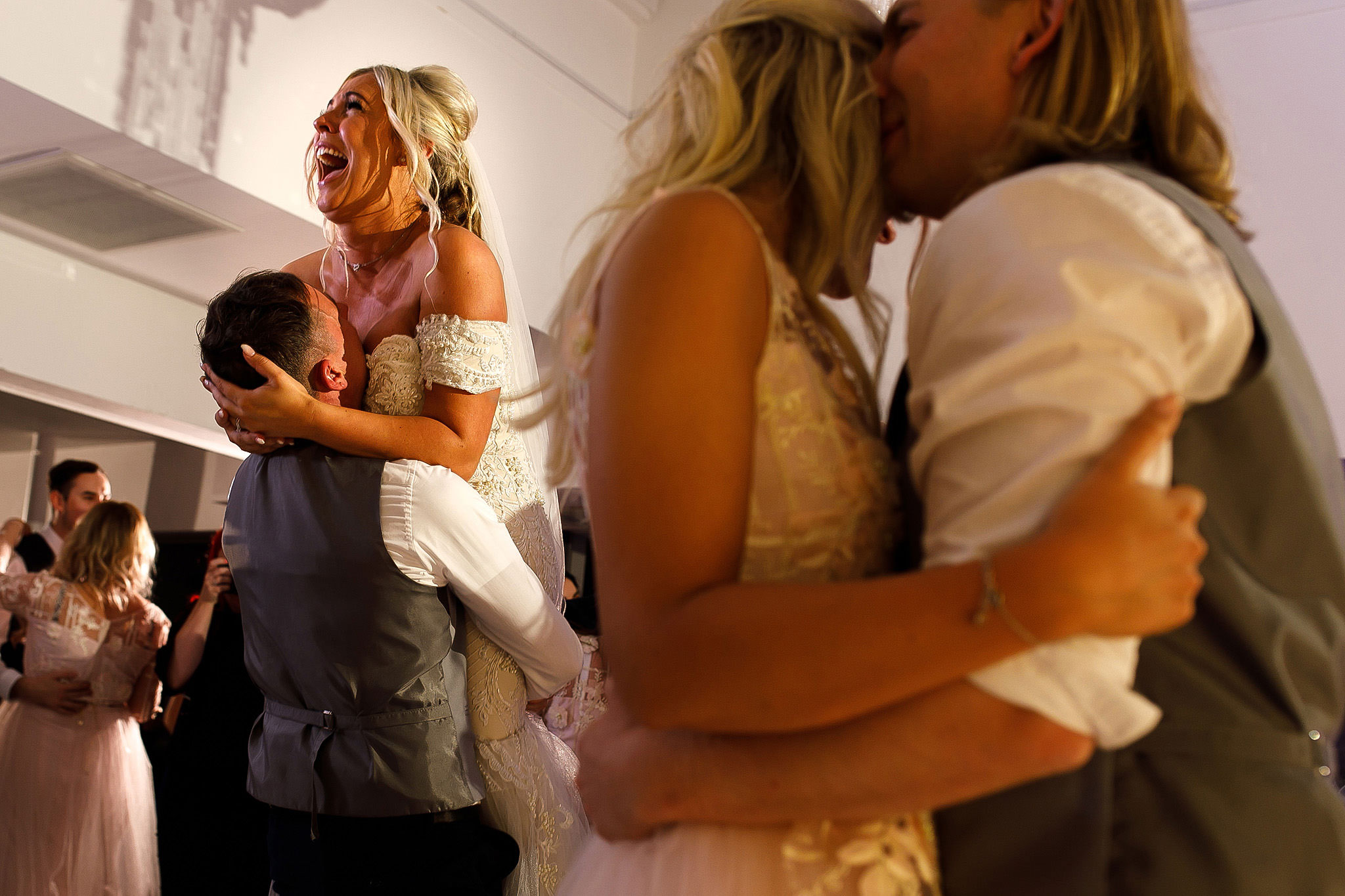 Groom lifting bride into the air on the dance floor at Hurlston Hall Wedding
