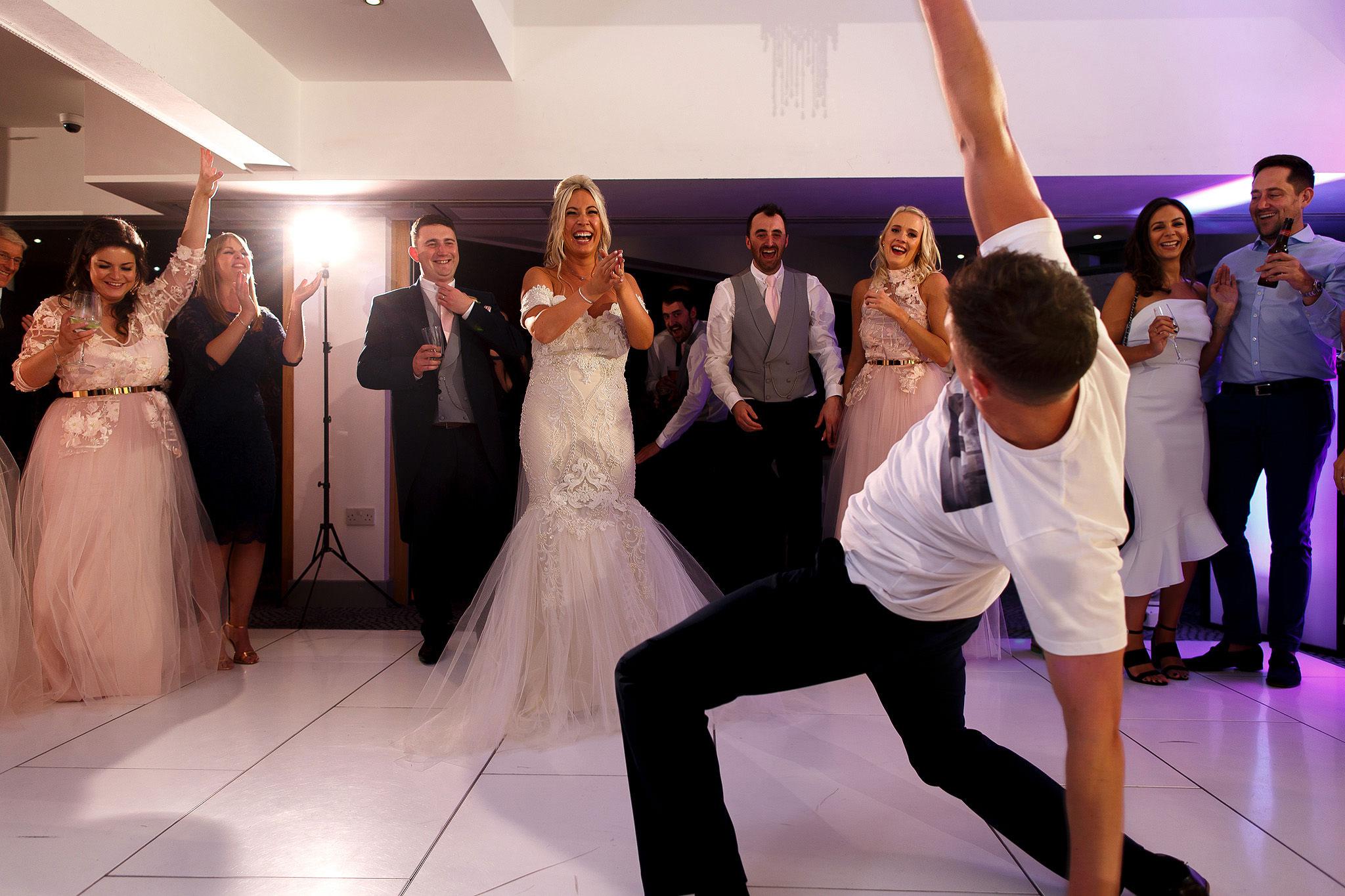 Groom break dancing on the dance floor at Hurlston Hall Wedding