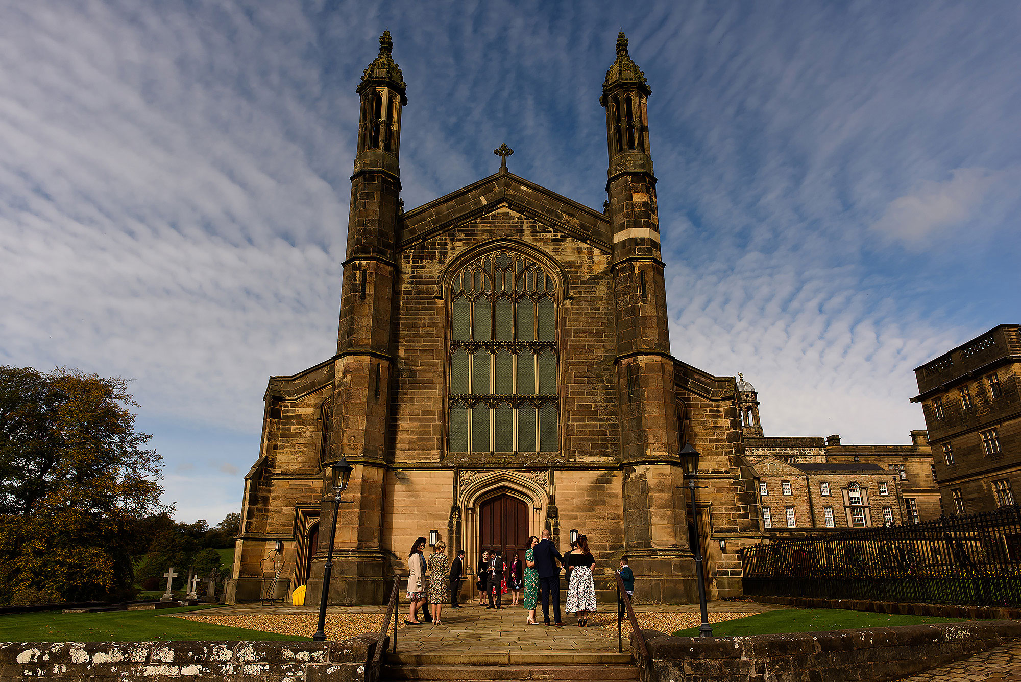 Wedding guests entering St Peters Church Stonyhurst for wedding ceremony - The Out Barn at Clough Bottom Wedding Photography