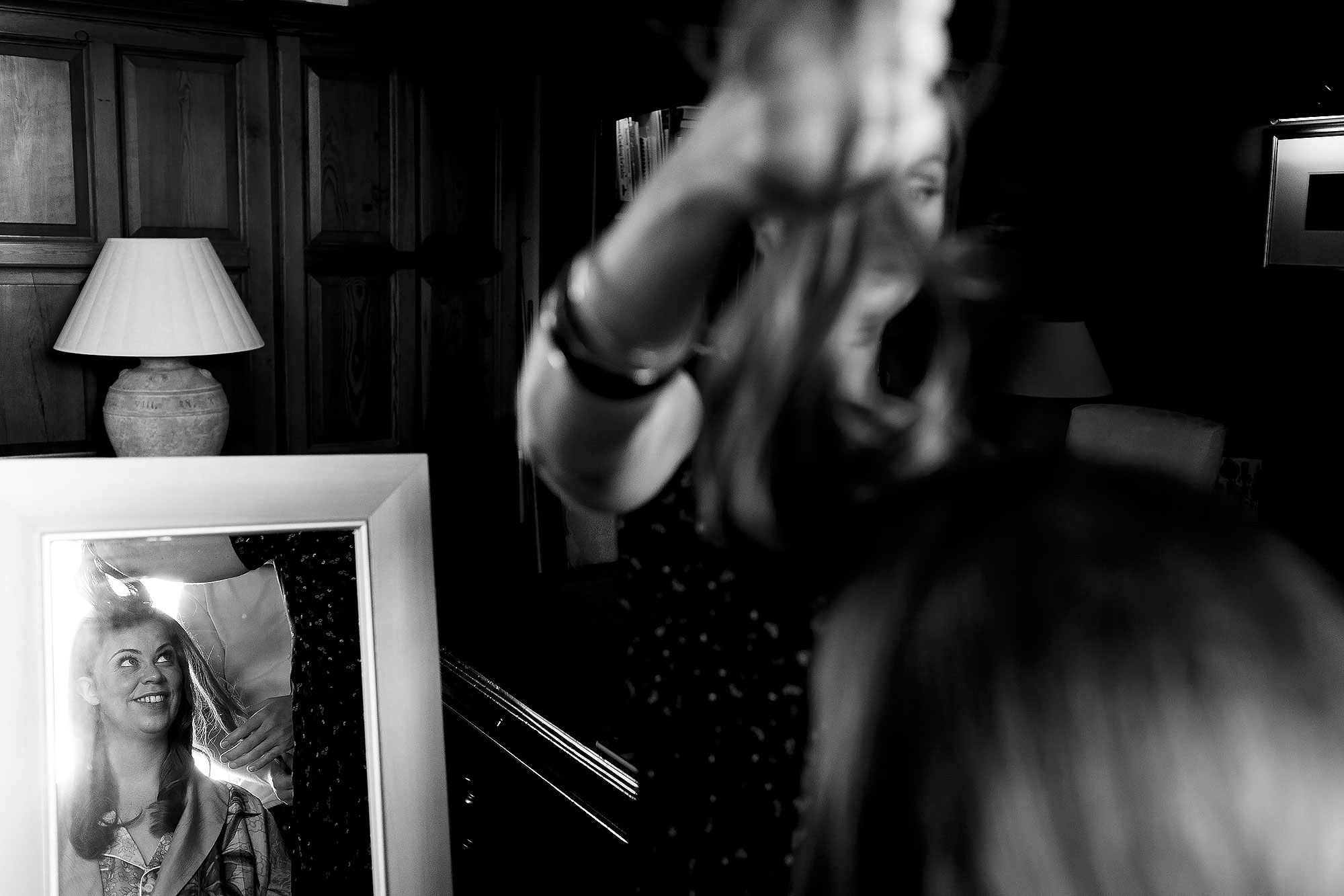 Brides reflection in a mirror as she has hair done for wedding day | Lake District Wedding by Toni Darcy Photography