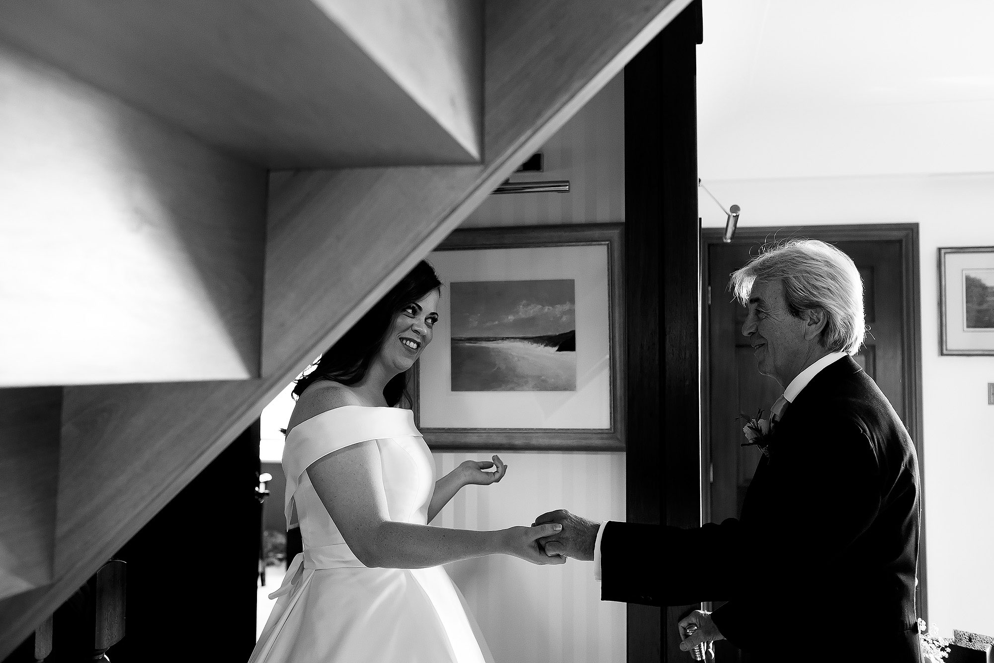 Bride seeing her father in her wedding dress for the first time. He is reaching out to offer her a hand | Lake District Wedding by Toni Darcy Photography