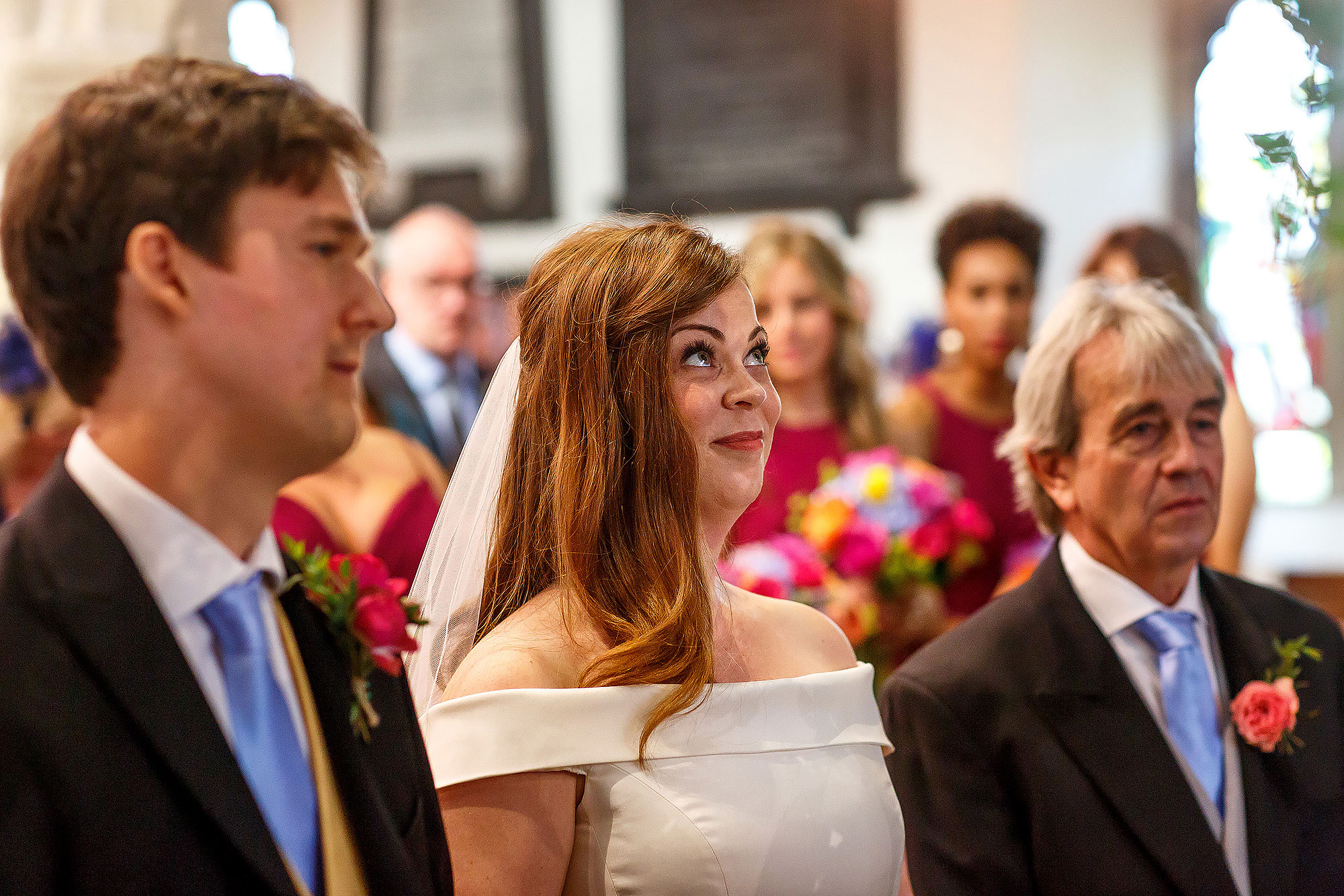 Bride with red hair looking up nervously in church | Lake District Wedding by Toni Darcy Photography