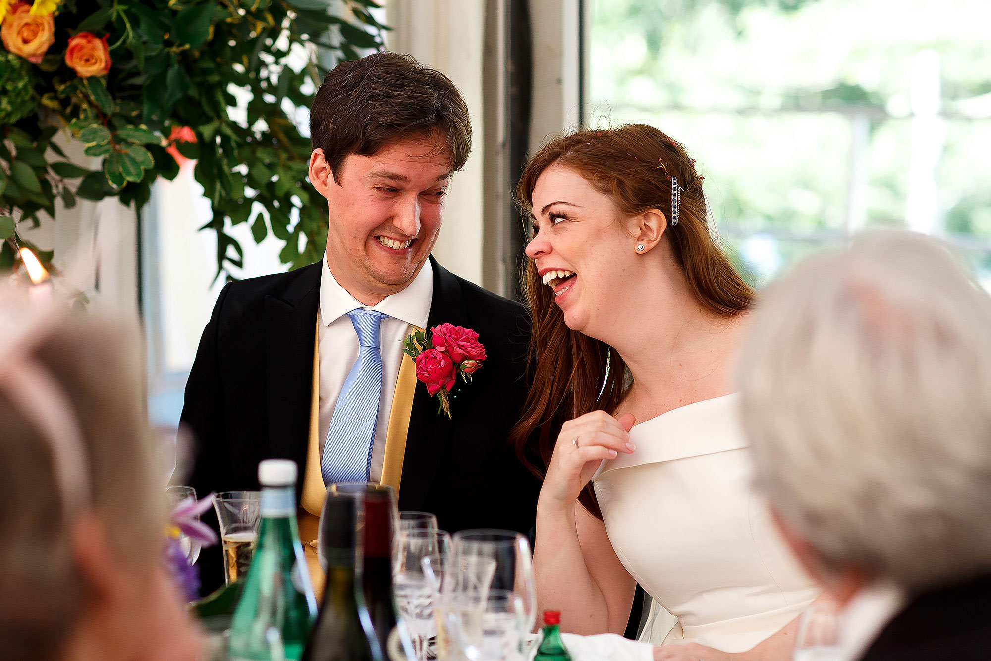 Bride and groom taking a little cheeky look to one another during wedding speeches | Lake District Wedding by Toni Darcy Photography