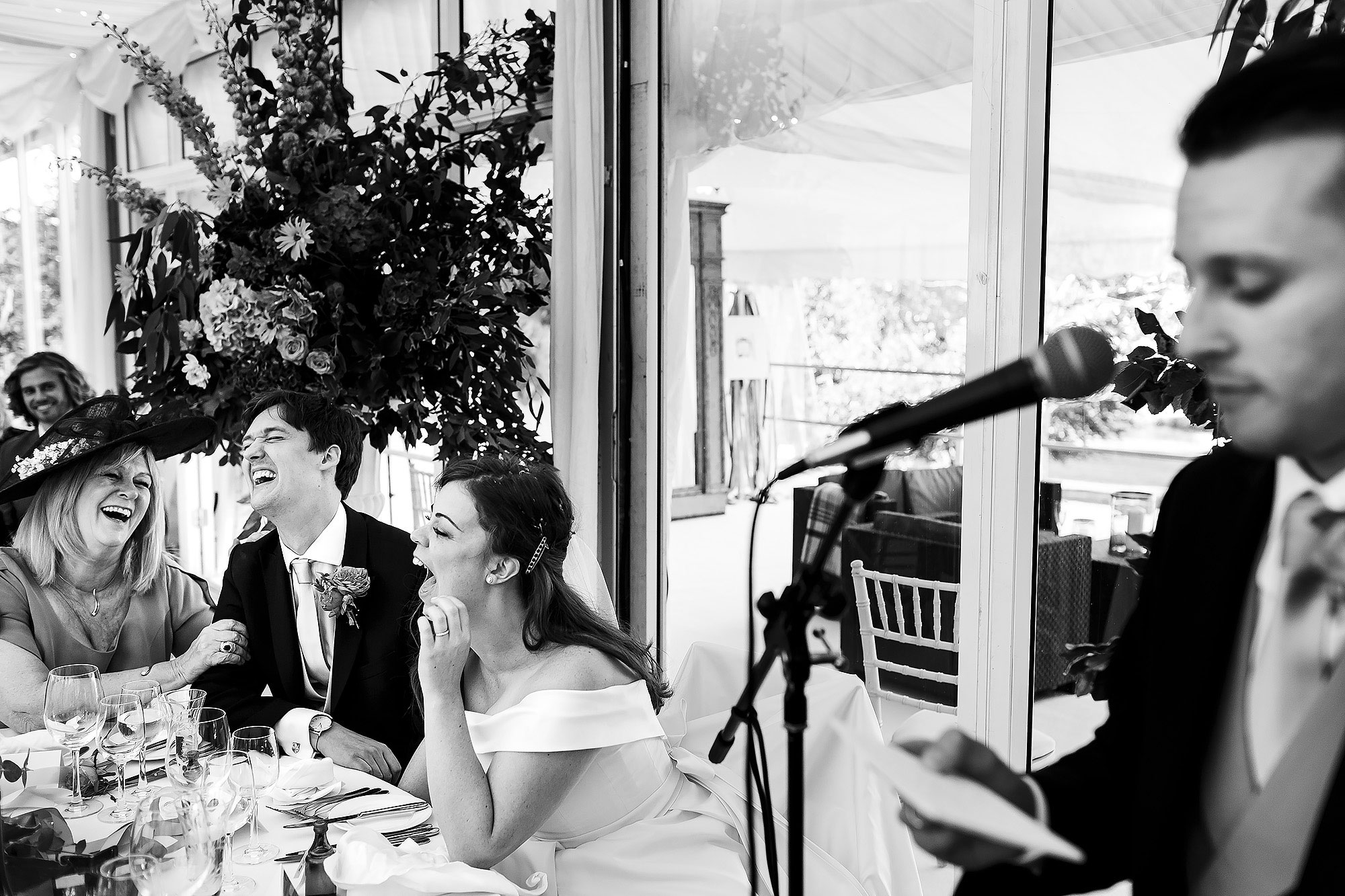 Top table laughing during wedding reception as best man makes a speech | Lake District Wedding by Toni Darcy Photography