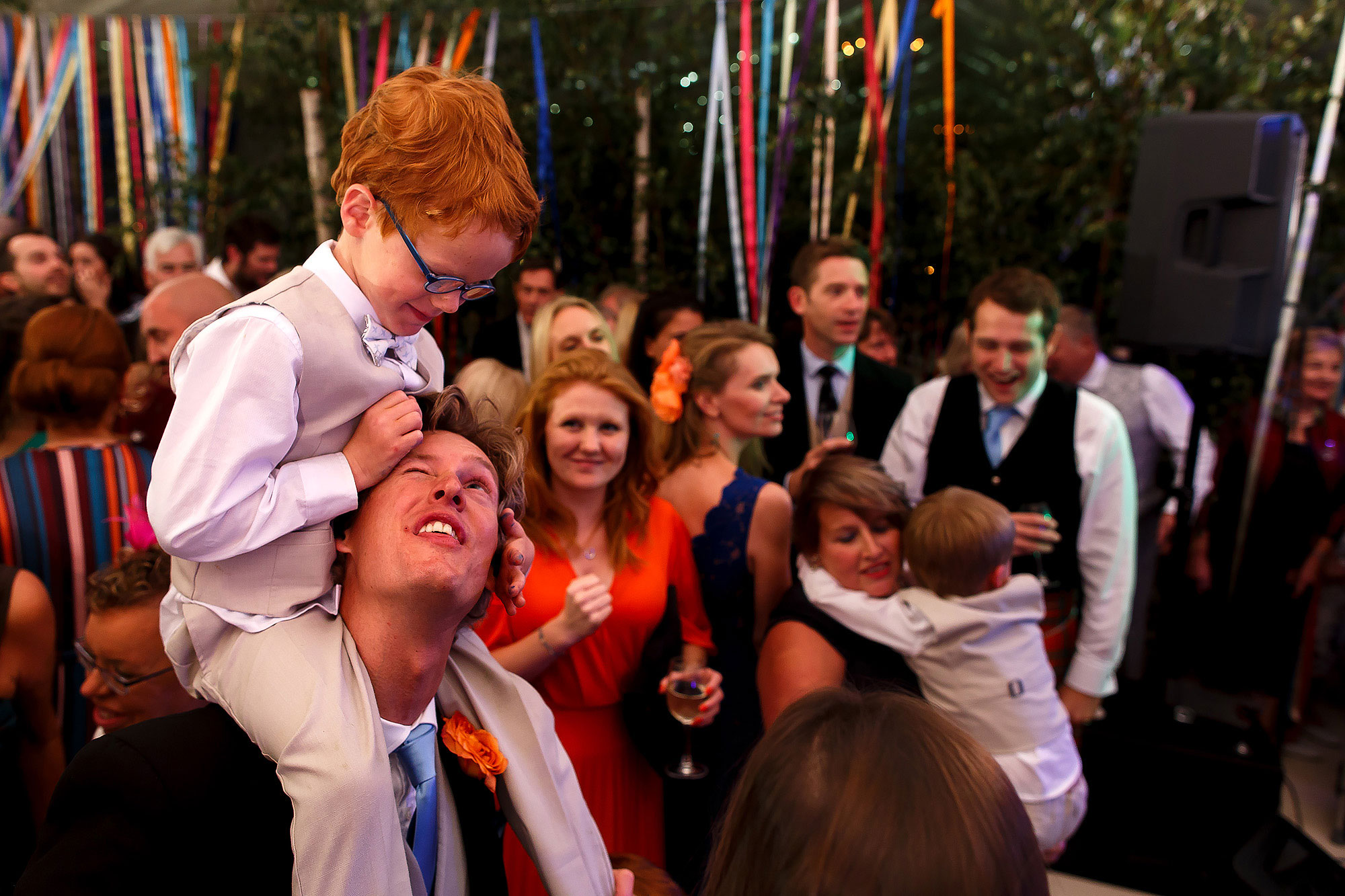 Ginger page boy sat on the shoulders of groomsmen on the wedding dance floor | Lake District Wedding by Toni Darcy Photography
