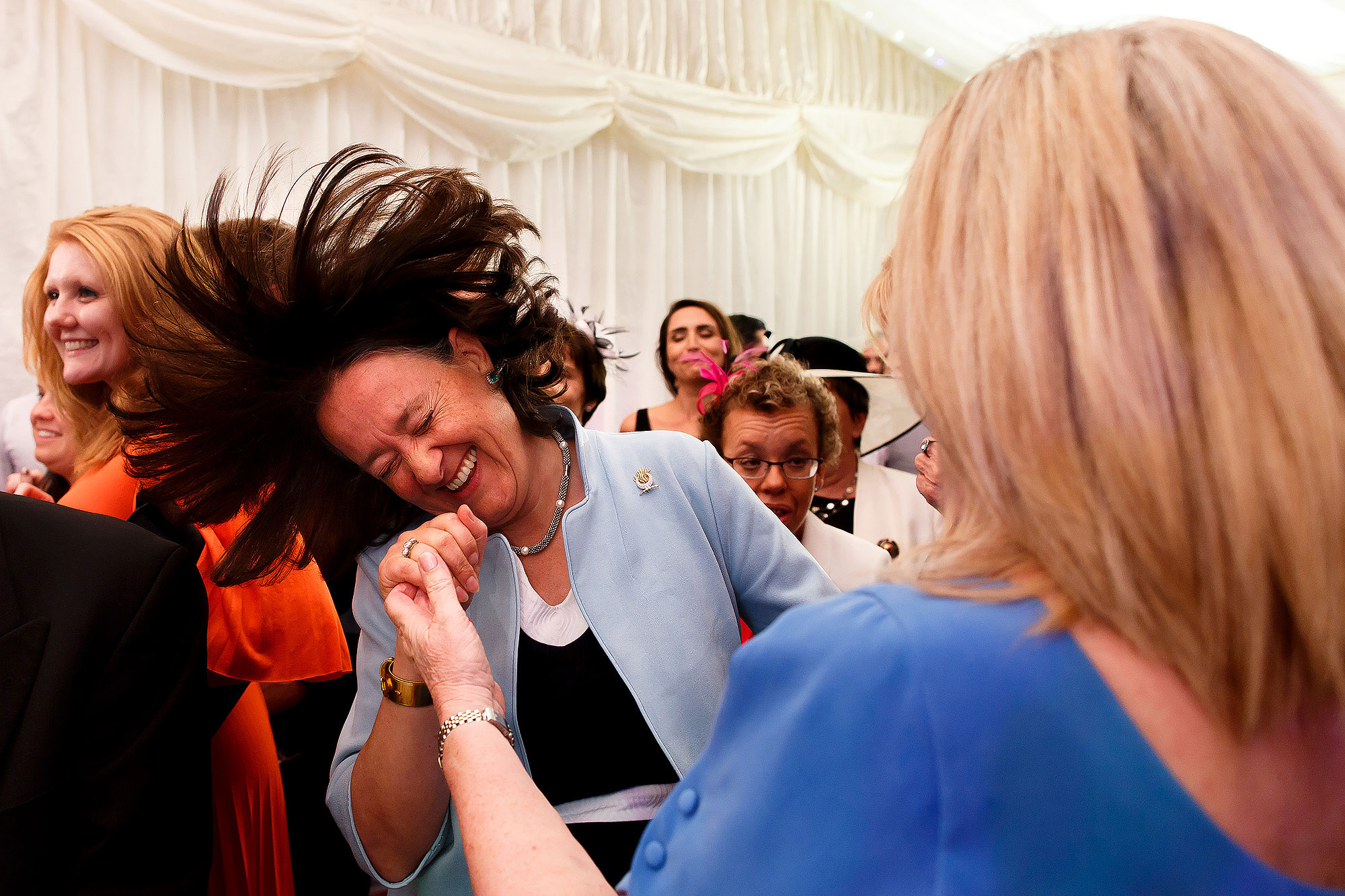 Wedding guests throwing their hair on the dance floor | Lake District Wedding by Toni Darcy Photography