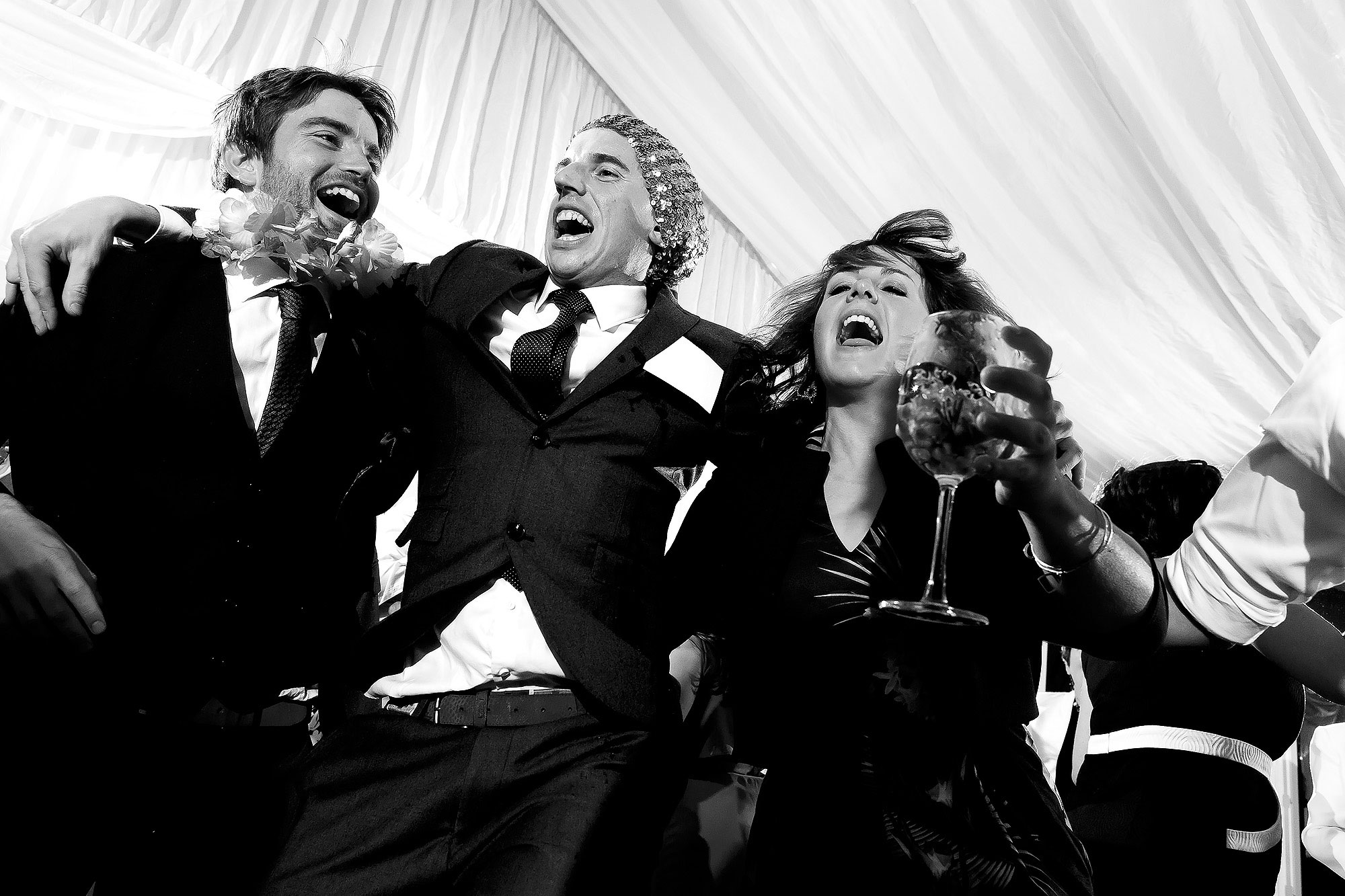 Wedding guests jumping around the marquee dance floor | Lake District Wedding by Toni Darcy Photography