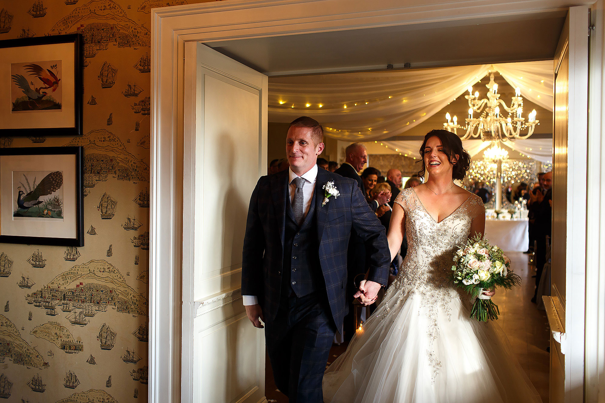Bride and groom walking out of wedding ceremony | Eaves Hall wedding photography by Toni Darcy