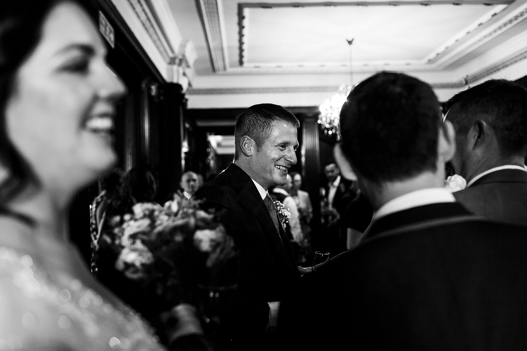 Bride and groom greeting and hugging wedding guests after the wedding ceremony | Eaves Hall wedding photography by Toni Darcy