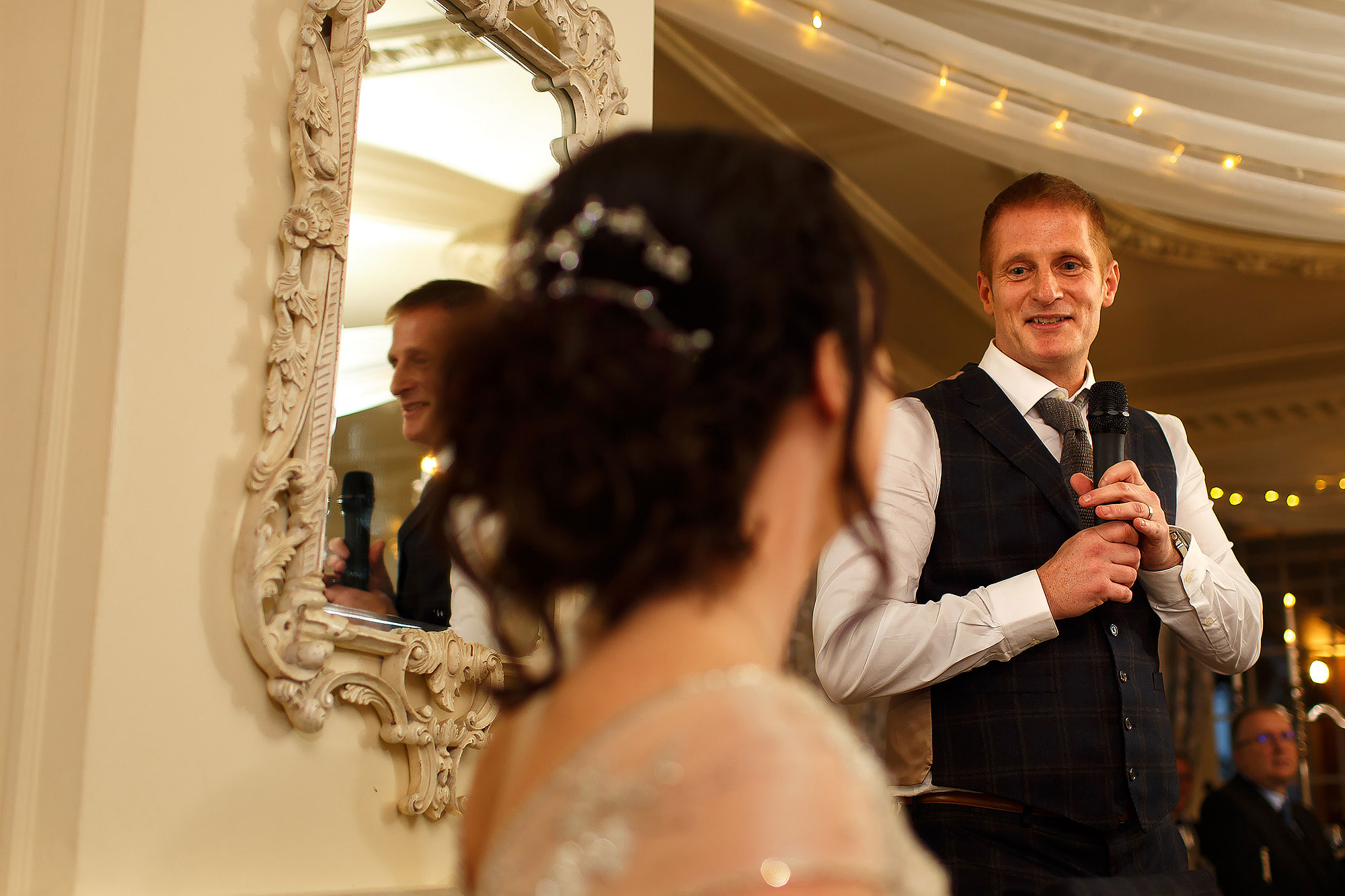 Groom looking towards the bride as he makes his wedding speech | Eaves Hall wedding photography by Toni Darcy