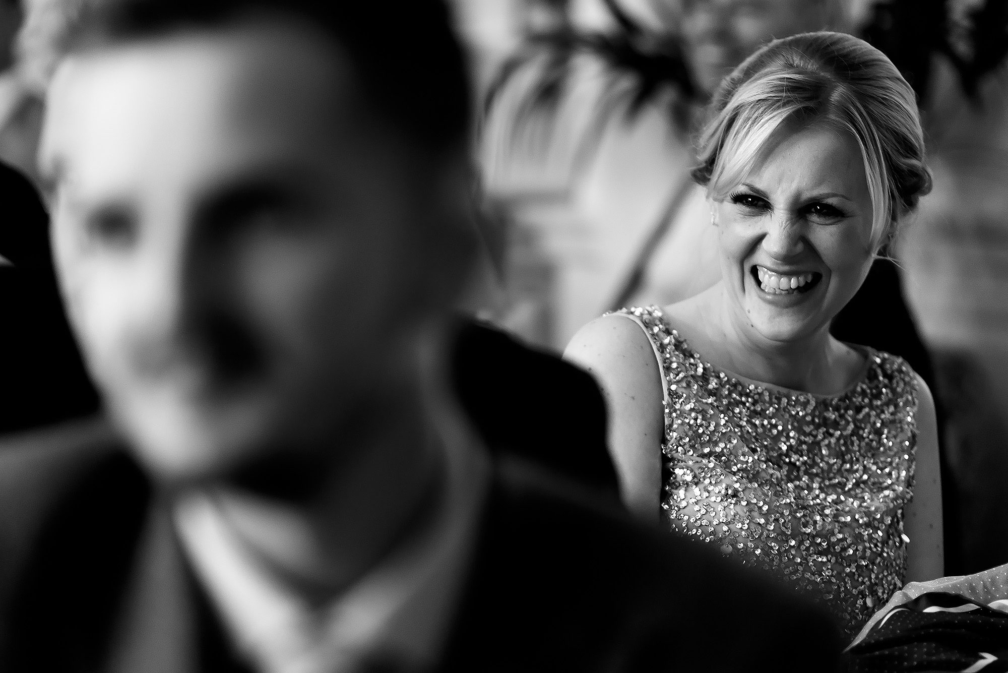 Wedding guests laughing during the speeches | Eaves Hall wedding photography by Toni Darcy