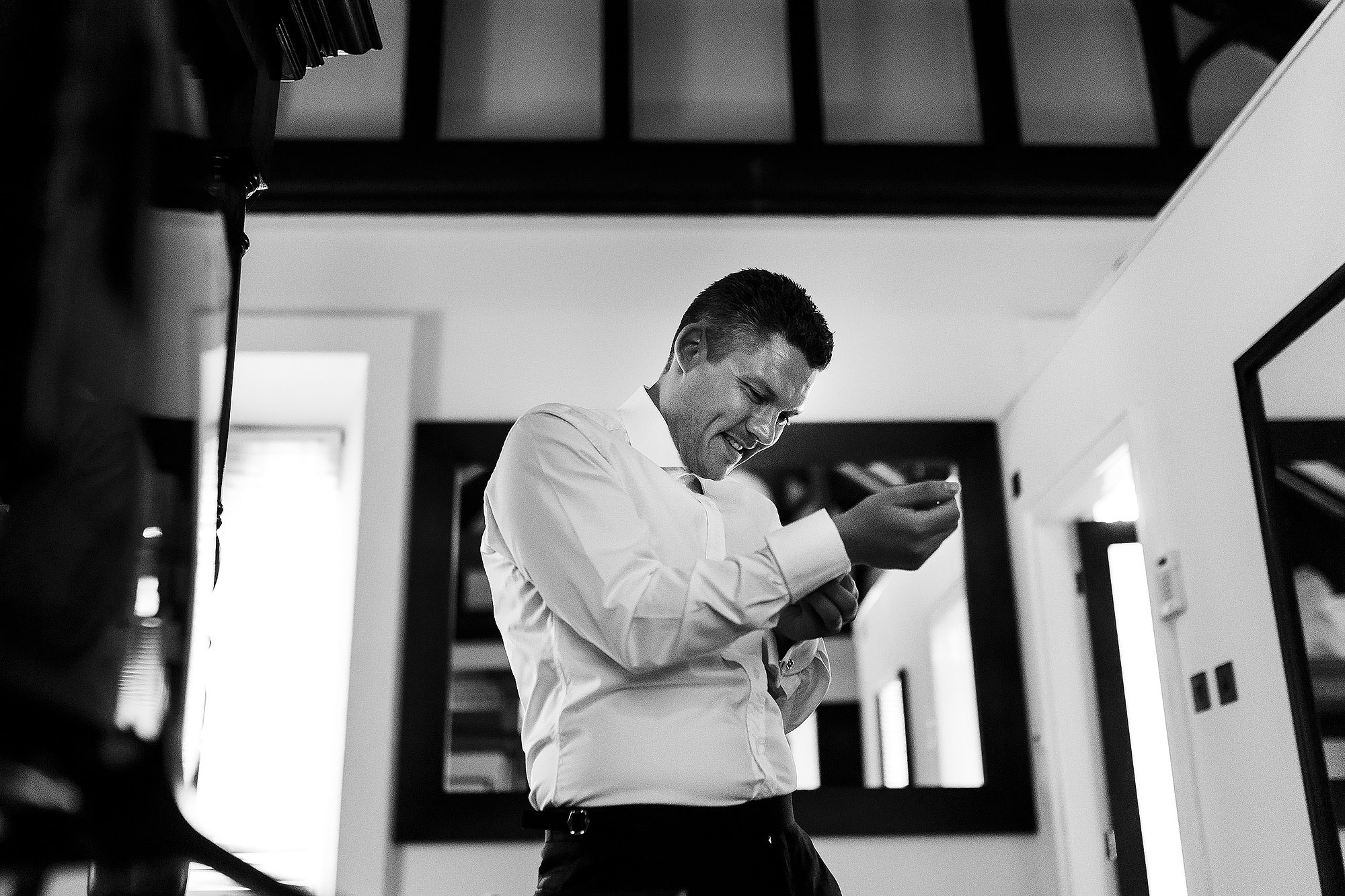Groom fastening his own cufflinks on the morning of his wedding day | Peckforton Castle Wedding by Toni Darcy Photography