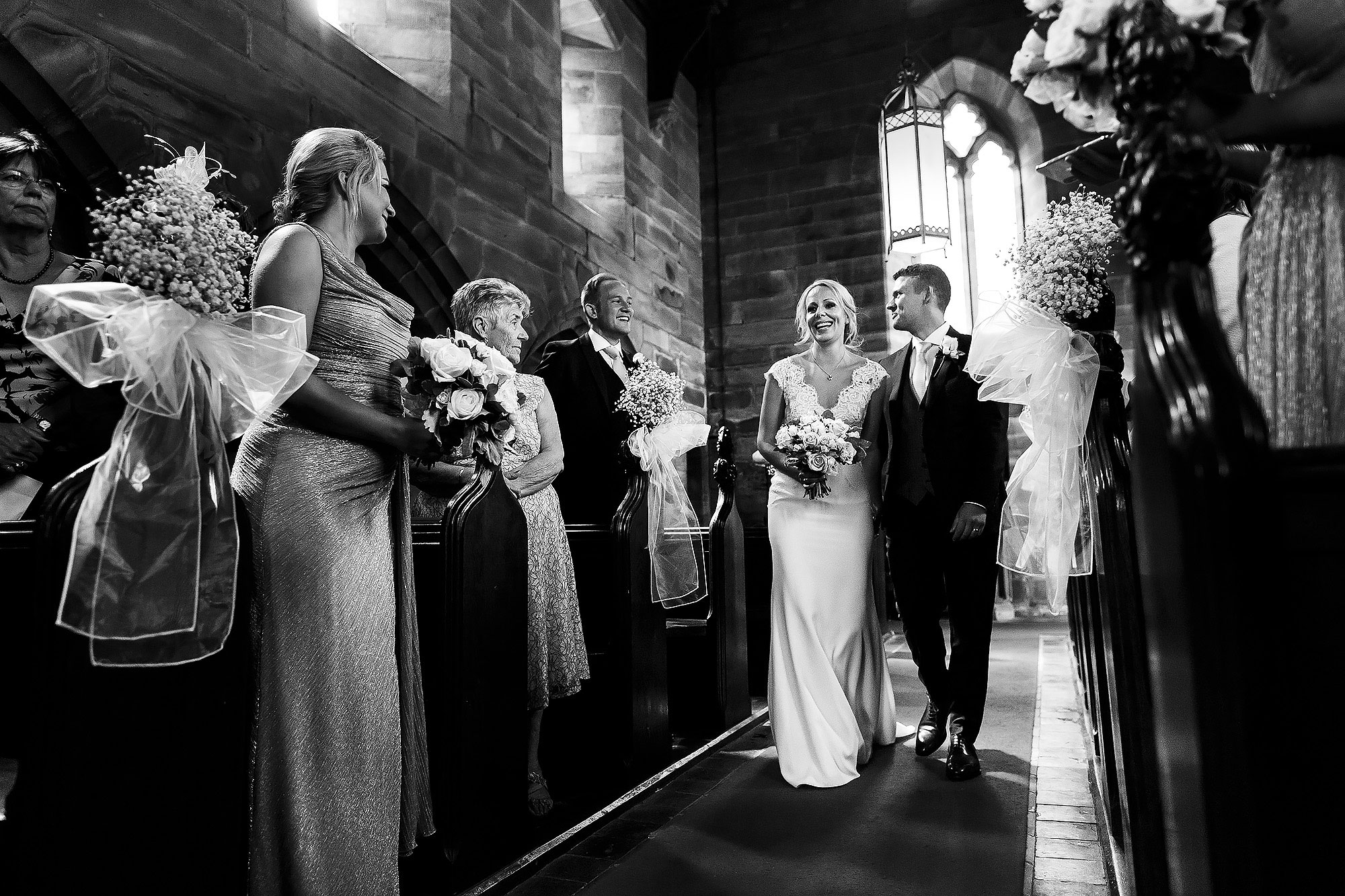 Bride and groom walking down the aisle of the chapel at Peckforton Castle | Peckforton Castle Wedding by Toni Darcy Photography