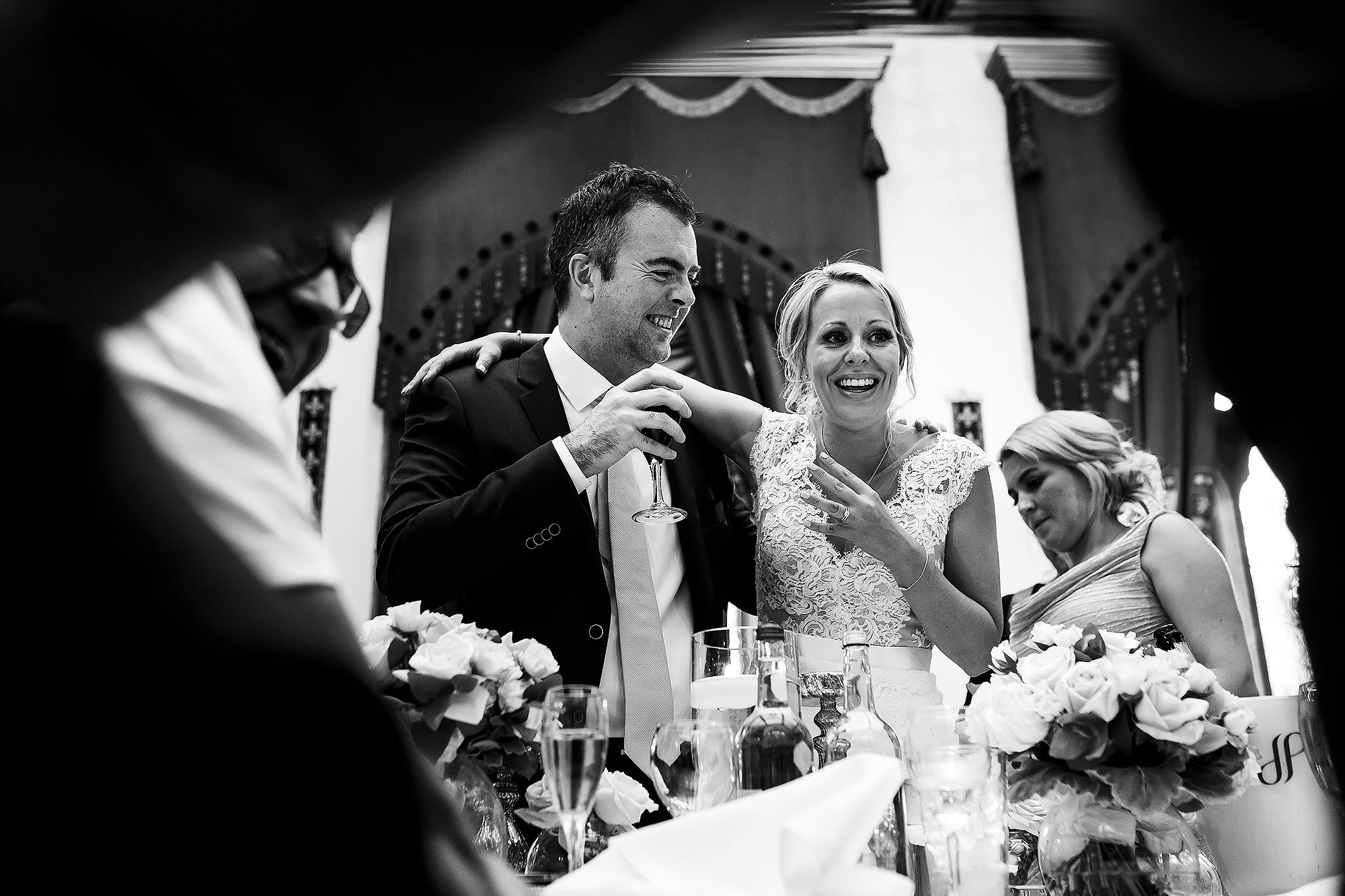 Bride hugging wedding guests during speeches | Peckforton Castle Wedding by Toni Darcy Photography