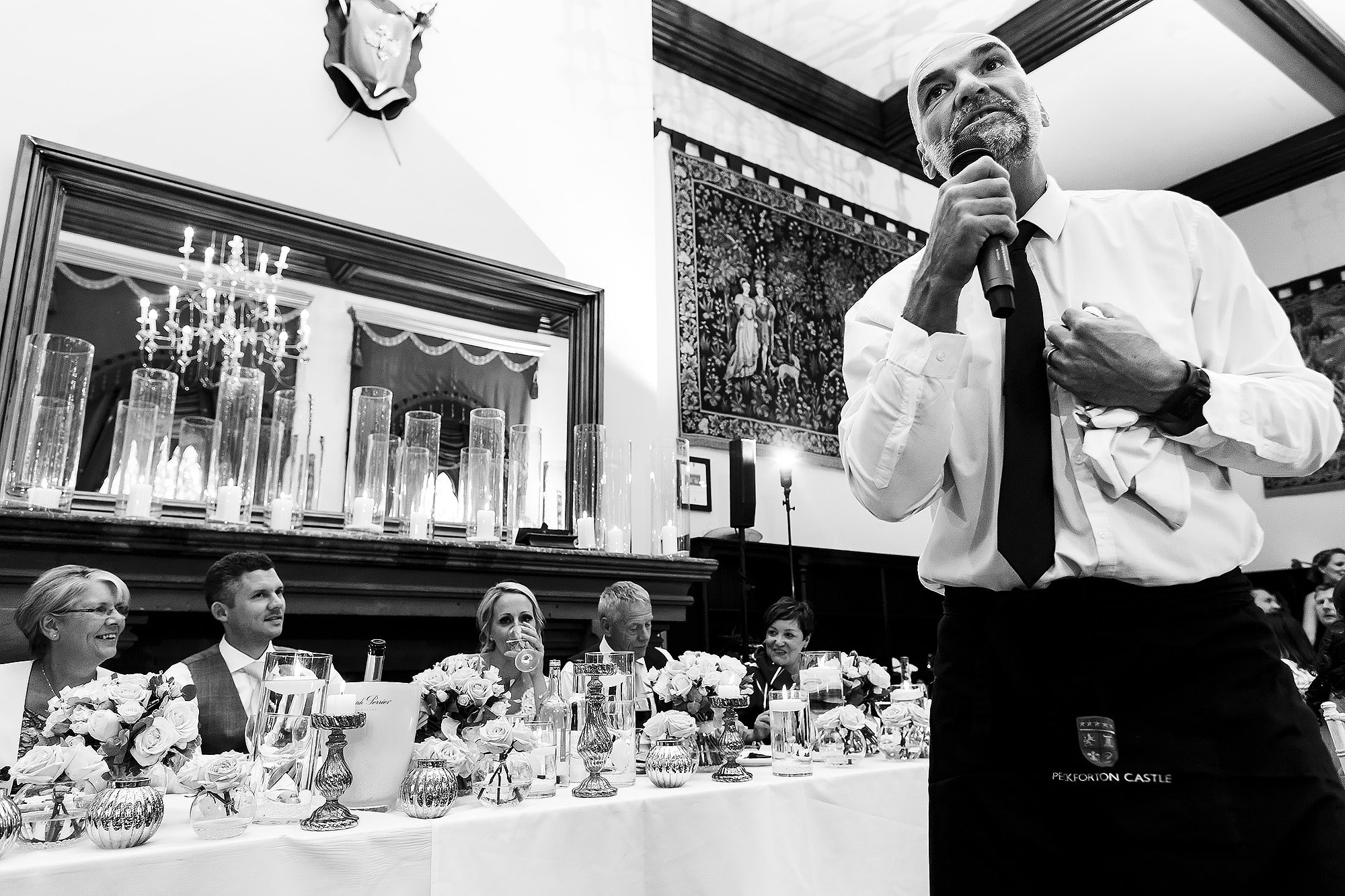 Singing waiters performing during wedding reception | Peckforton Castle Wedding by Toni Darcy Photography
