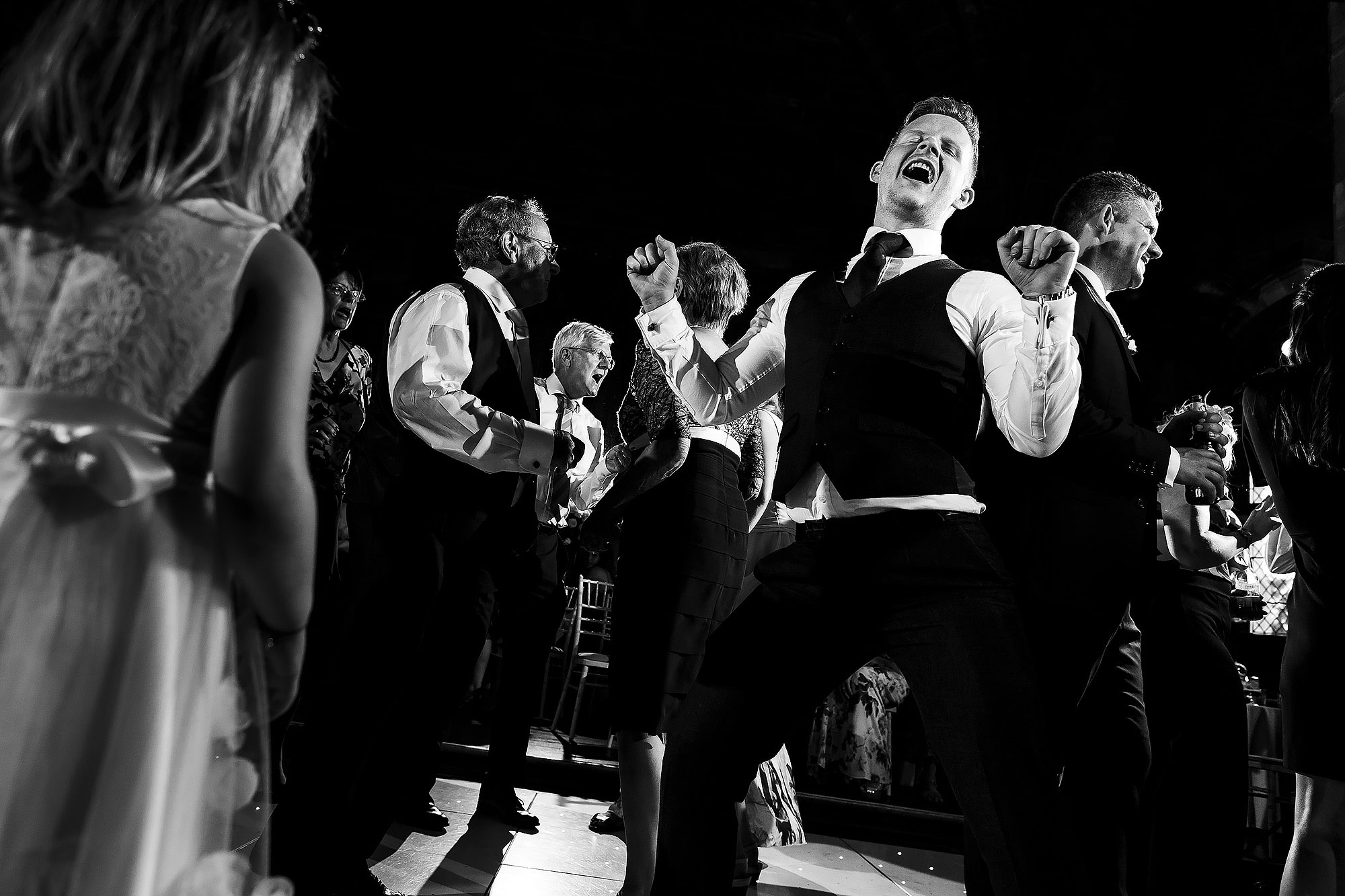 Wedding guests partying on the dance floor | Peckforton Castle Wedding by Toni Darcy Photography