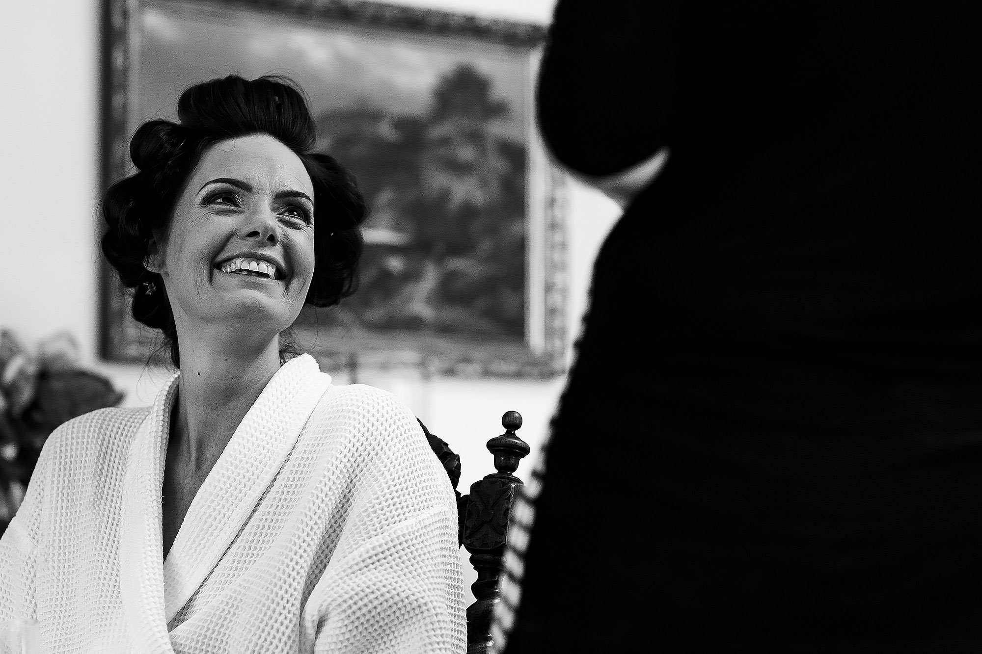 Bride laughing having make up applied on the morning of her wedding | Summer wedding at Wellbeing Farm - Toni Darcy Photography