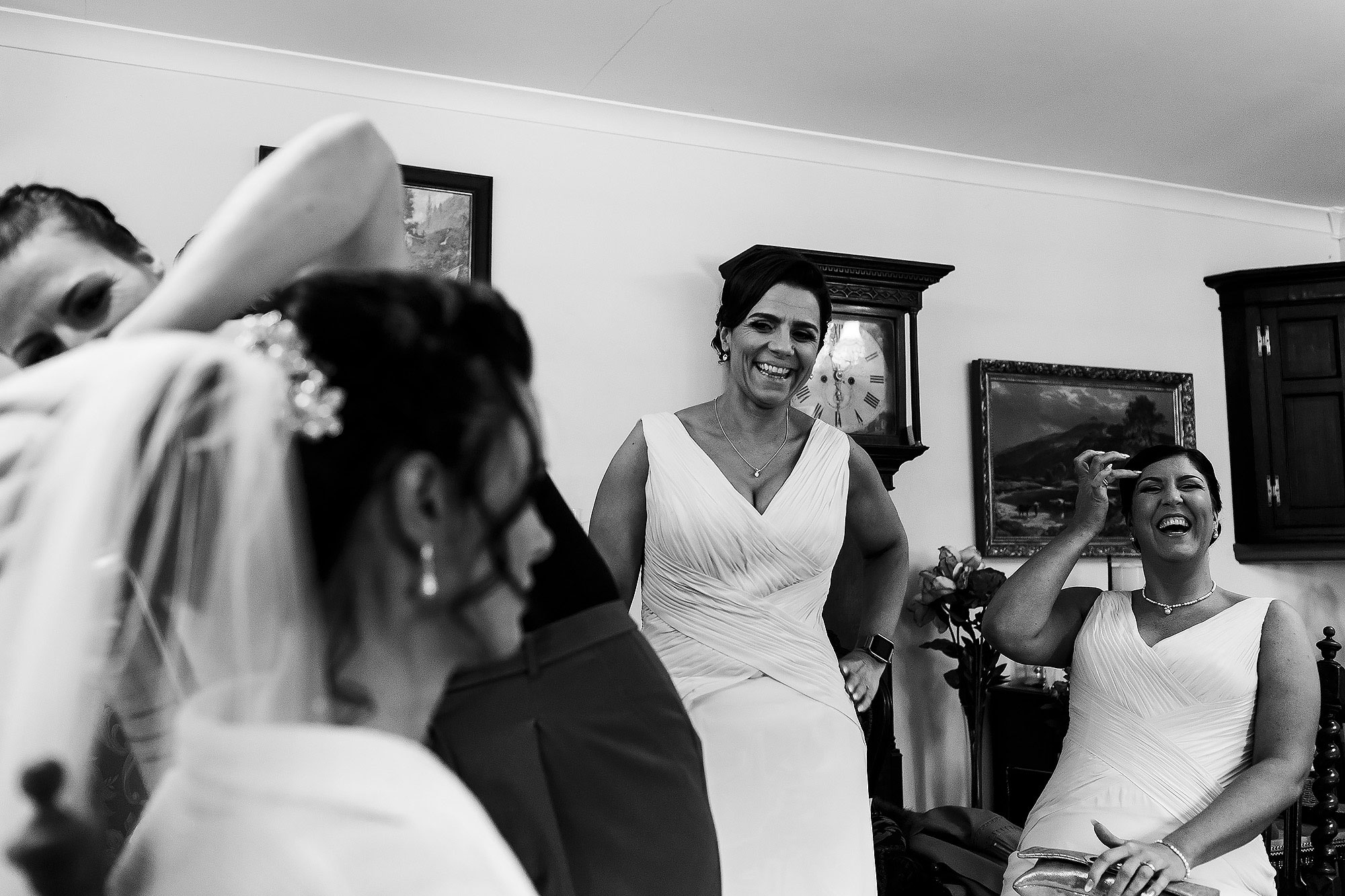 Bridesmaids laughing as the bride has the veil placed in her hair | Summer wedding at Wellbeing Farm - Toni Darcy Photography