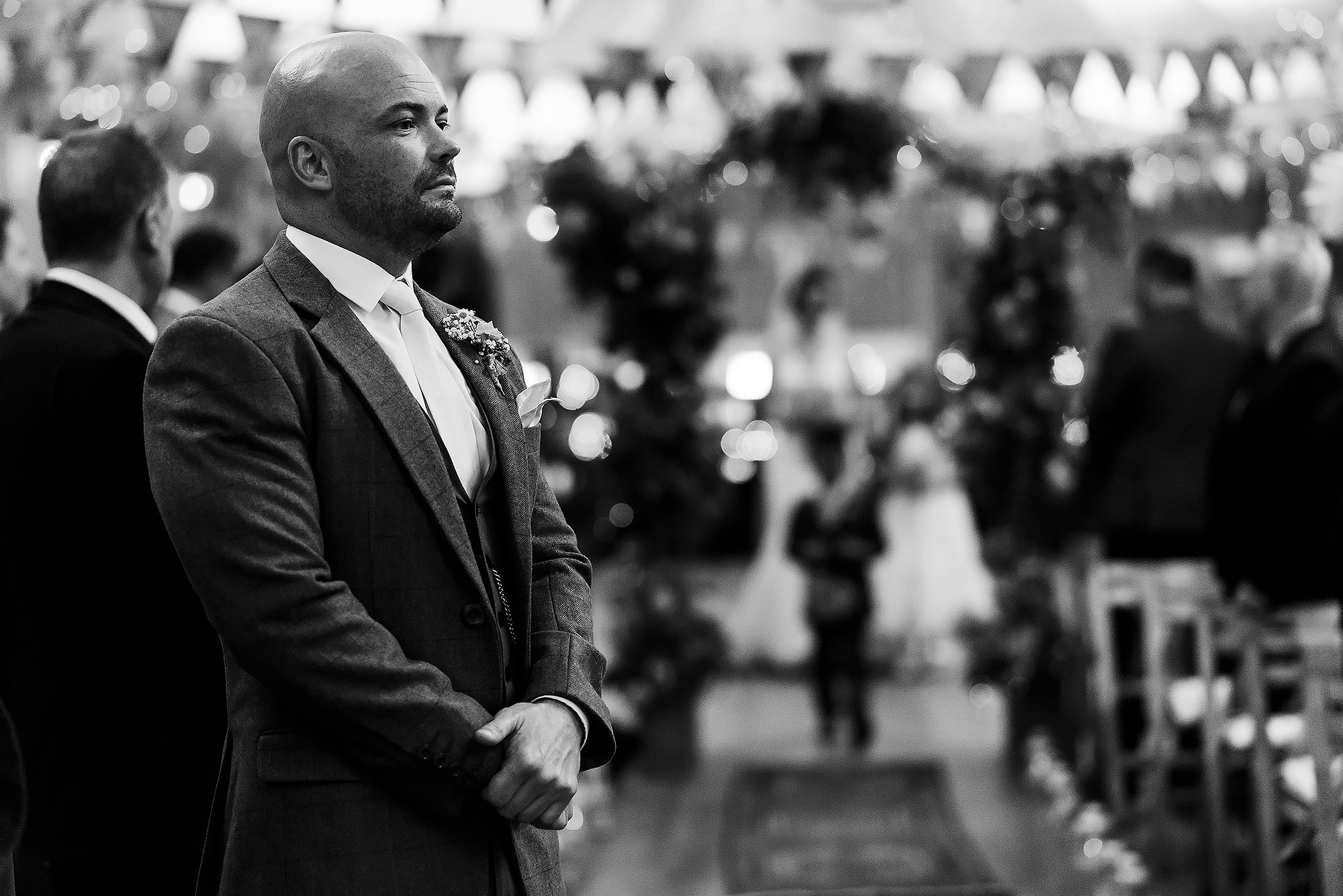 Groom looking nervous walking at the front of the wedding aisle | Summer wedding at Wellbeing Farm - Toni Darcy Photography