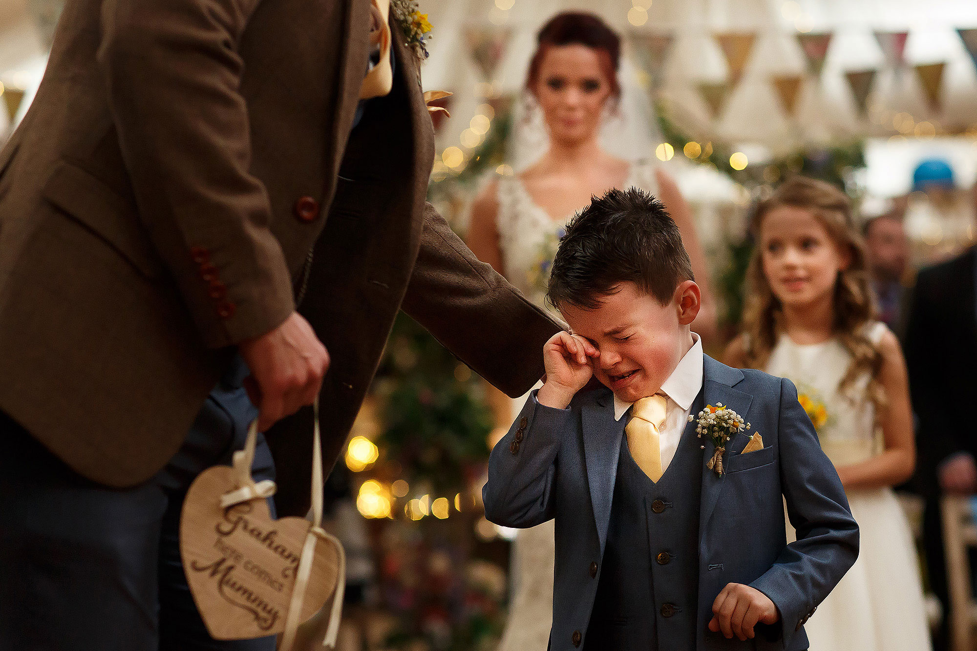 Cute page boy breaking down into tears when he arrives at the top of the wedding aisle to see his Dad | Summer wedding at Wellbeing Farm - Toni Darcy Photography