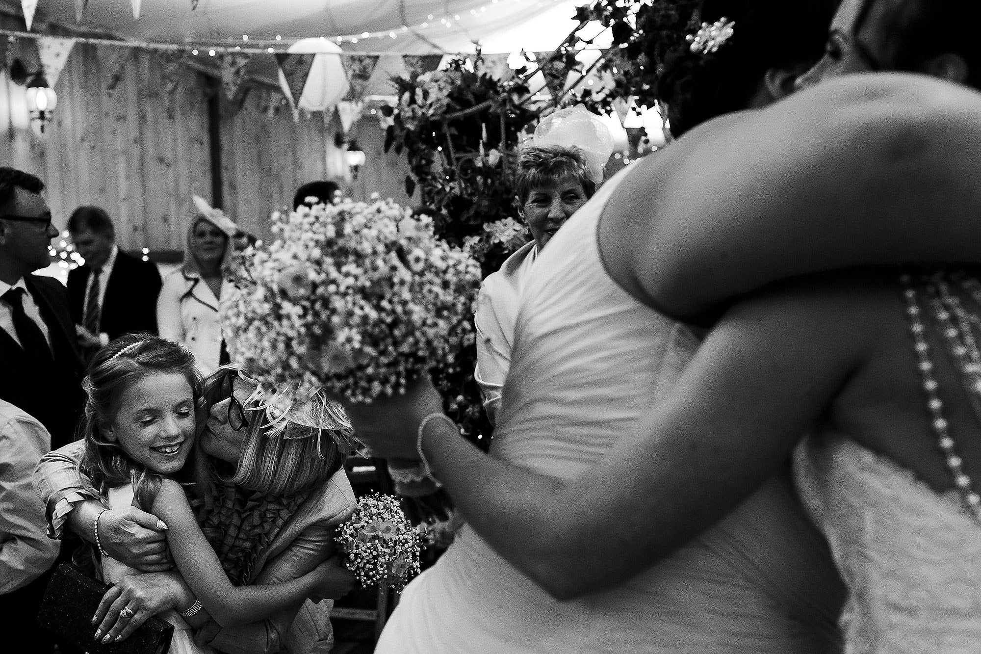 Wedding guests hugging after wedding ceremony | Summer wedding at Wellbeing Farm - Toni Darcy Photography