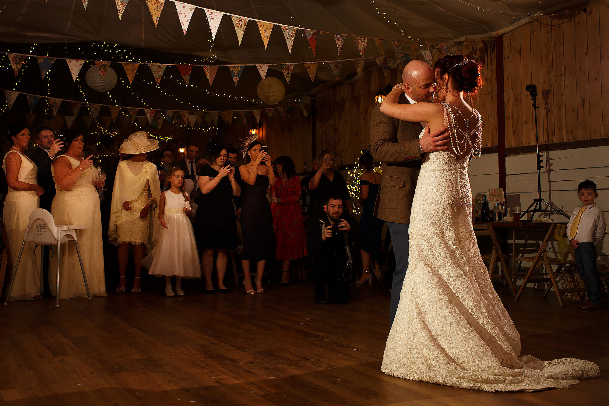 Bride and grooms first dance as wedding guests watch | Summer wedding at Wellbeing Farm - Toni Darcy Photography