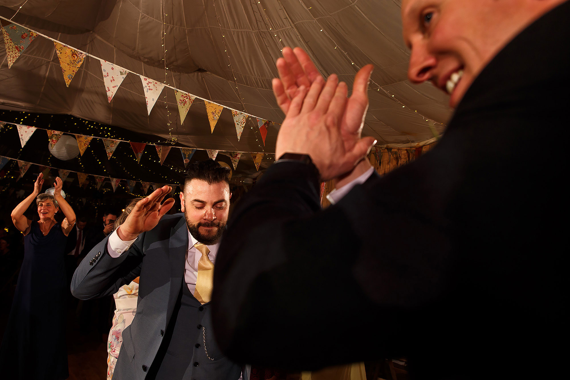 Wedding guests ceilidh dancing | Summer wedding at Wellbeing Farm - Toni Darcy Photography
