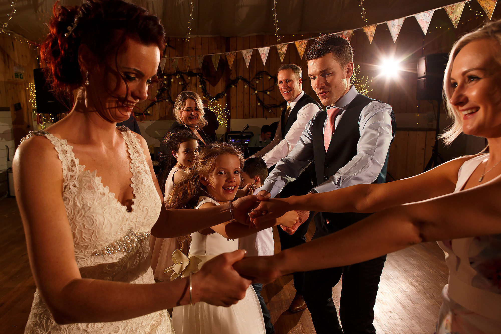 Bride ceilidh dancing with wedding guests | Summer wedding at Wellbeing Farm - Toni Darcy Photography